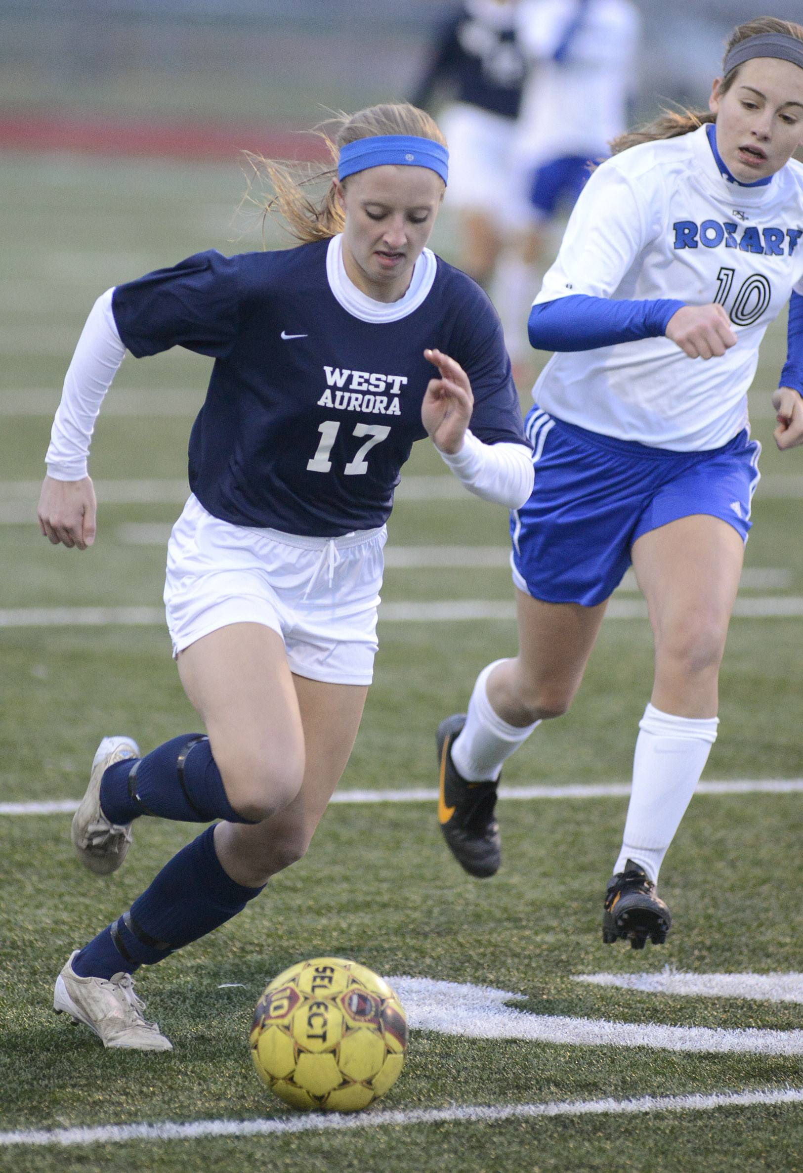 West Aurora's Sam O'Brien is trailed by Rosary's Sonya Popovich in the second half.