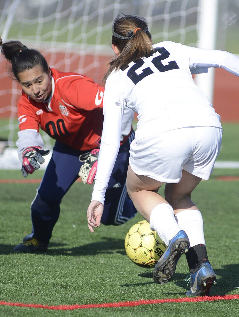 East Aurora's goalie Ruby Garcia dives to grab a ball before Kaneland's Holly Collingbourne can score a goal in the first half on Wednesday, April 16.