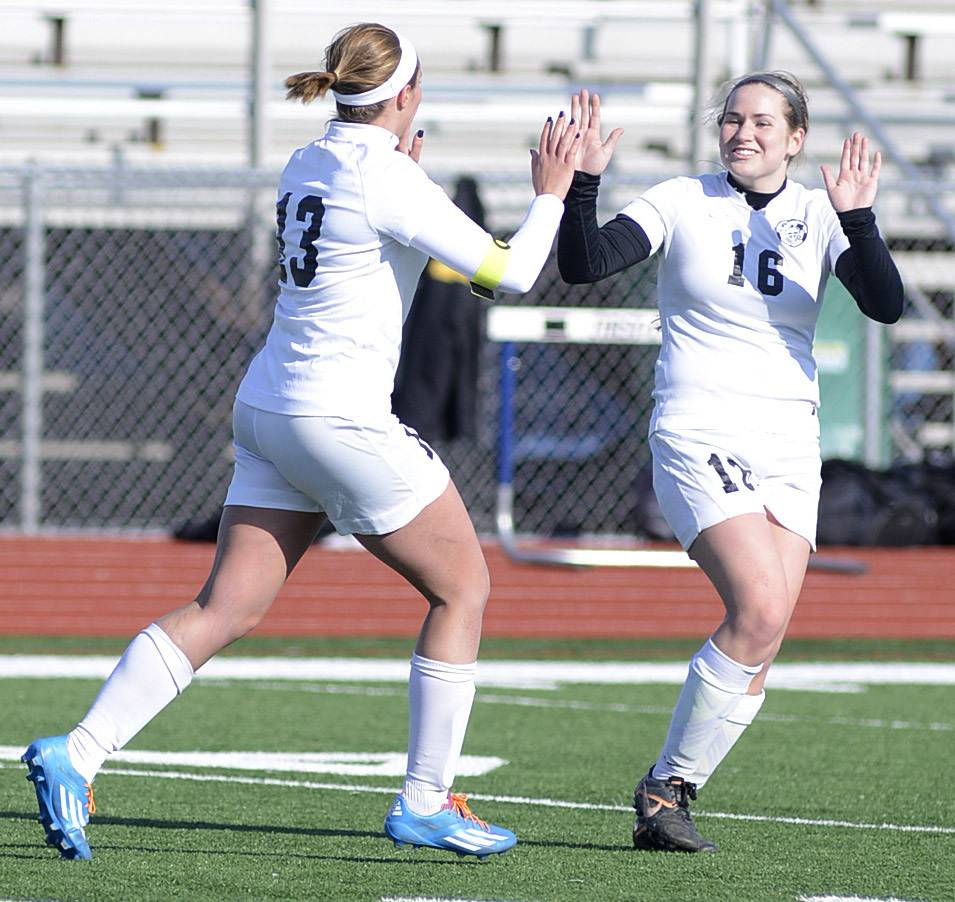 Kaneland's Delaney Stryczek, left, gets congrats from teammate Emily Grams after scoring a goal over East Aurora in the first half on Wednesday, April 16.