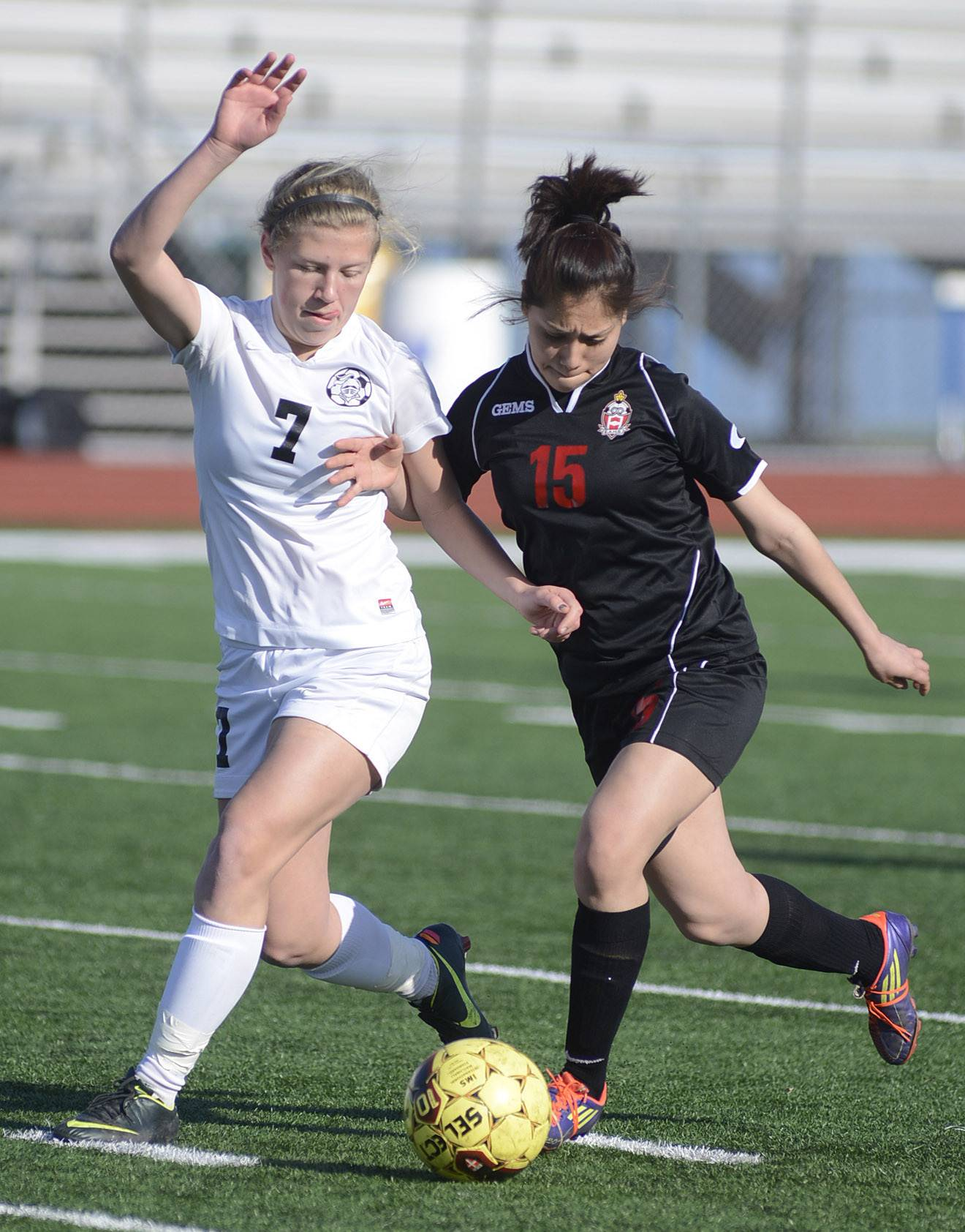 Kaneland's Heather Ortiz and East Aurora's Jacqueline Palestina battle for the ball in the first half on Wednesday, April 16.