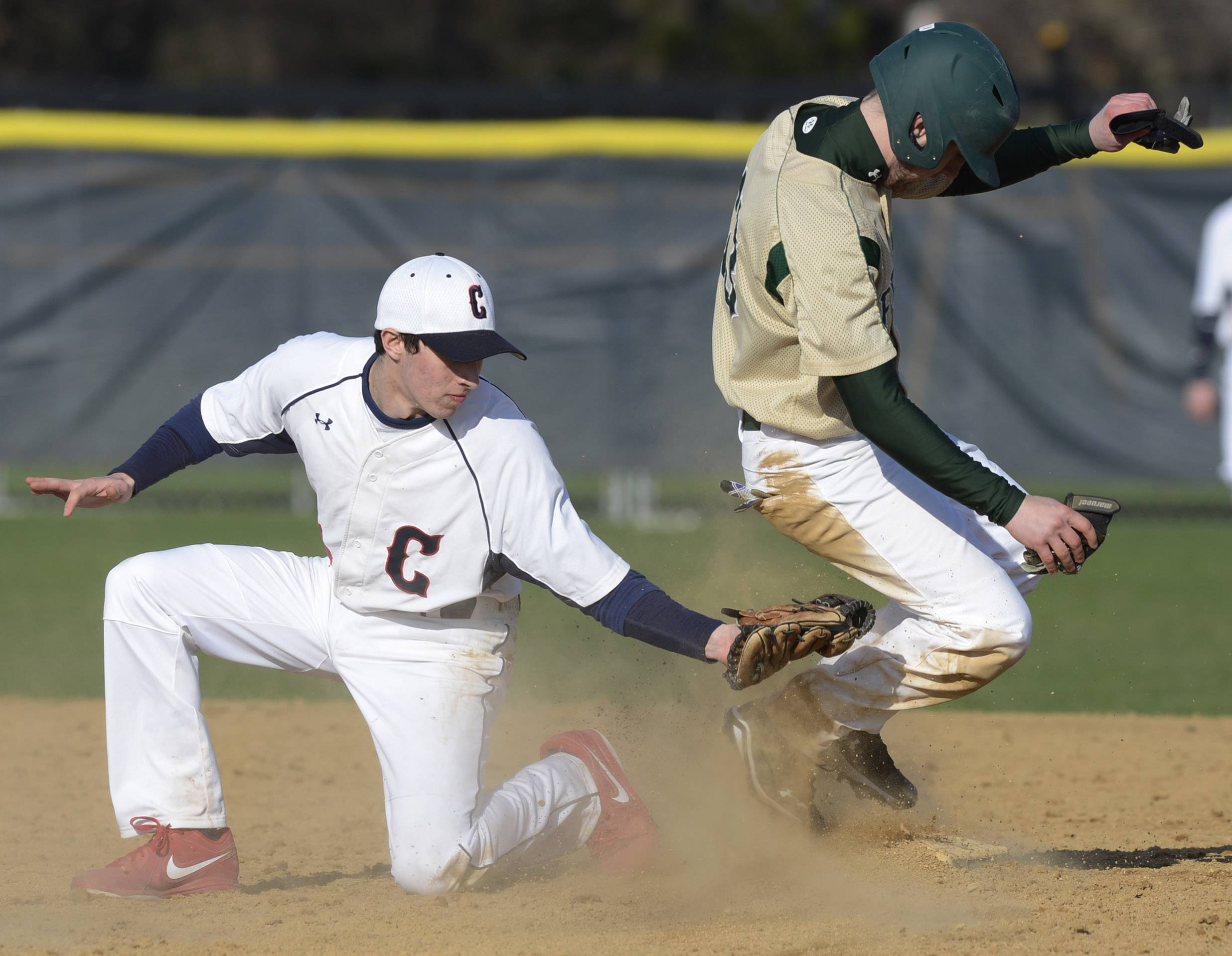 Fremd's Jack Miller, right, steals second base as Conant's Jordan Wolff applies the late tag during Wednesday's game in Hoffman Estates.