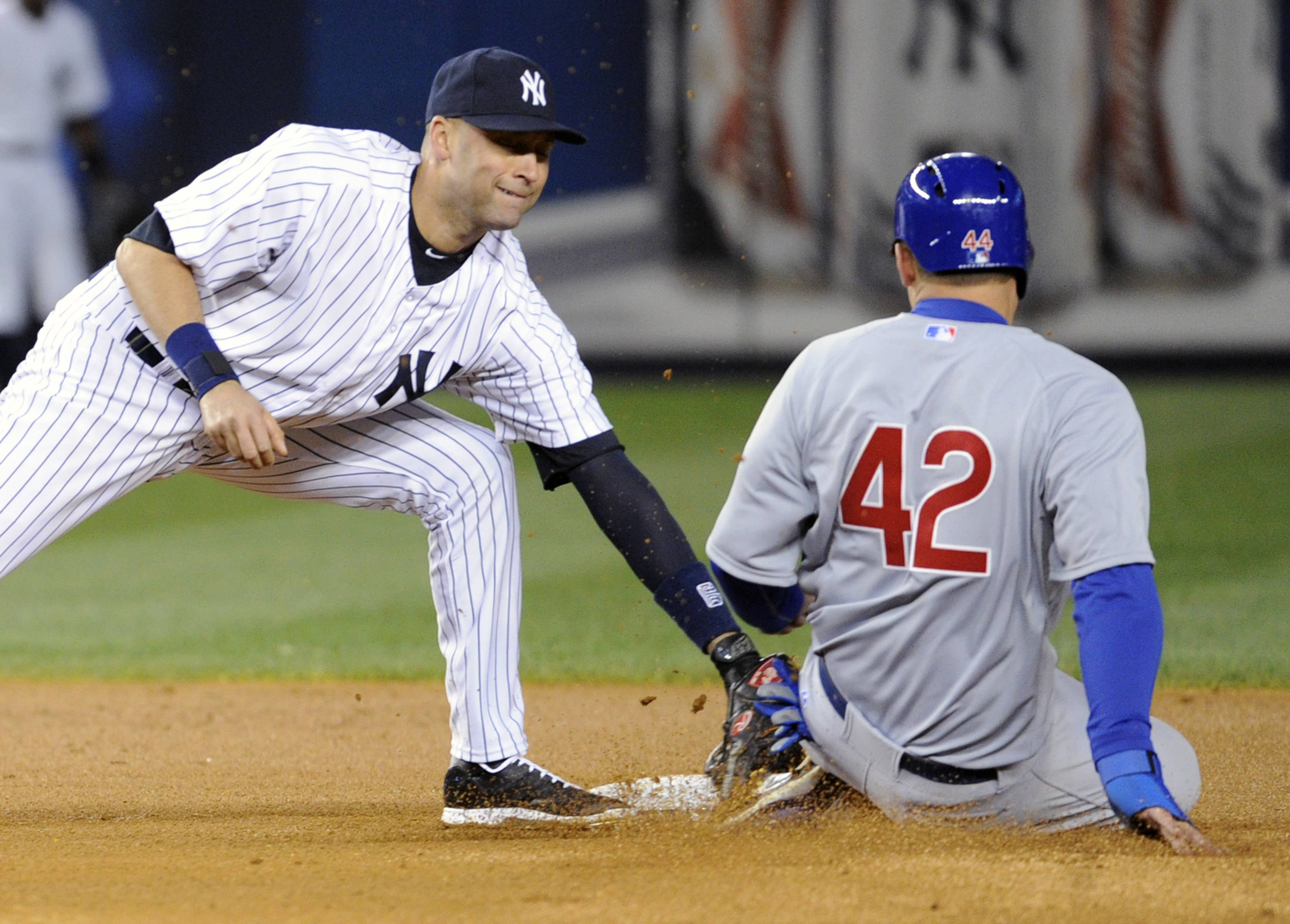New York Yankees shortstop Derek Jeter, left, tags out Chicago Cubs' Anthony Rizzo who was attempting to steal second base during the fourth inning of Game 2 of an interleague baseball doubleheader on Wednesday, April 16, 2014, at Yankee Stadium in New York.