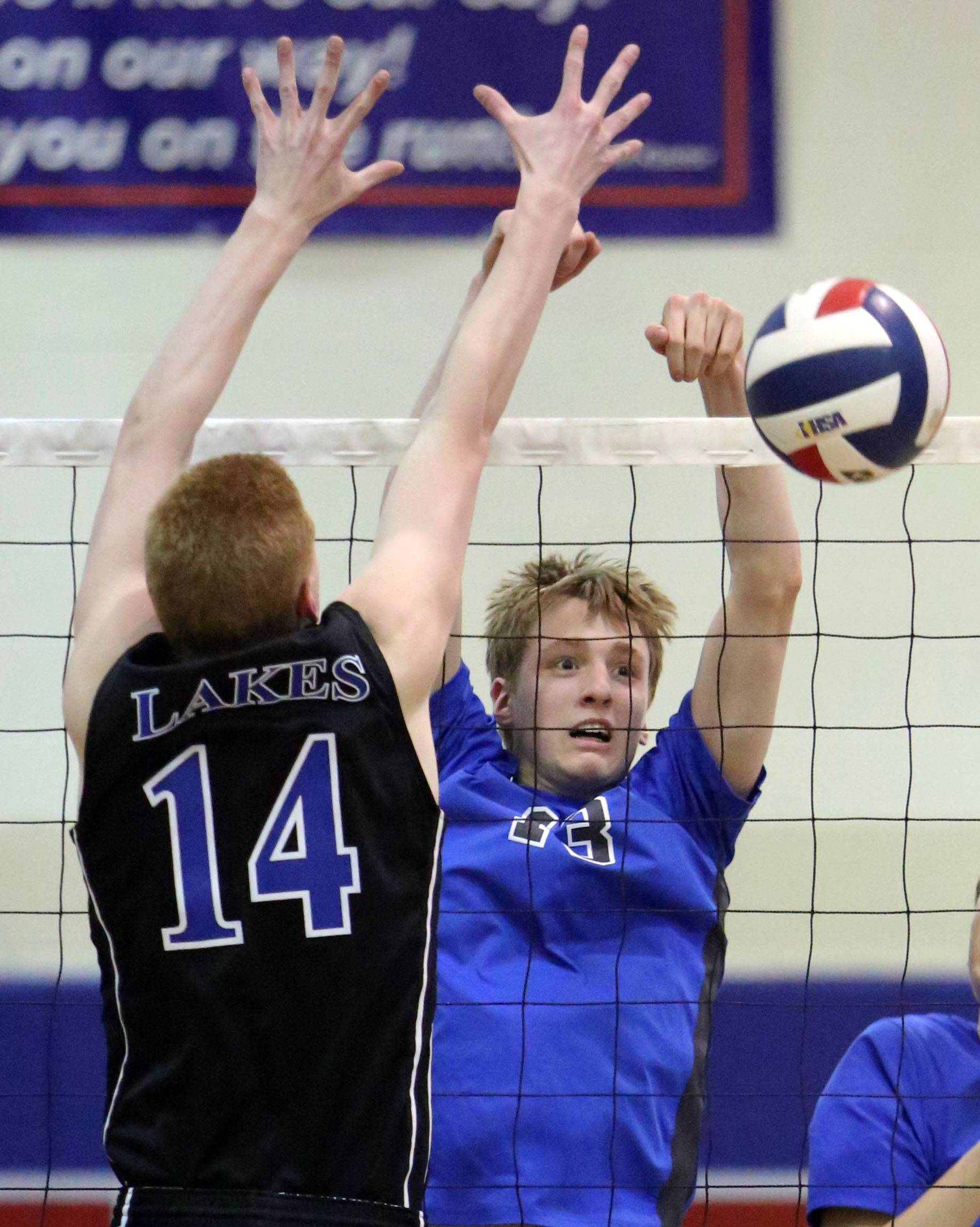 Lakes' Dakota Mathez, left, and Vernon Hills' Tyler Small meet at the net Wednesday at Lakes.