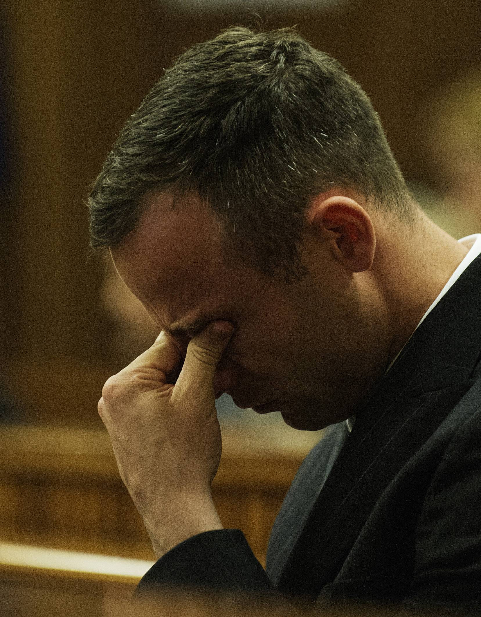 Oscar Pistorius reacts as he listens to forensic evidence being given in court in Pretoria, South Africa, Wednesday, April 16, 2014.  Pistorius is charged with the murder of his girlfriend, Reeva Steenkamp, on Valentines Day in 2013.