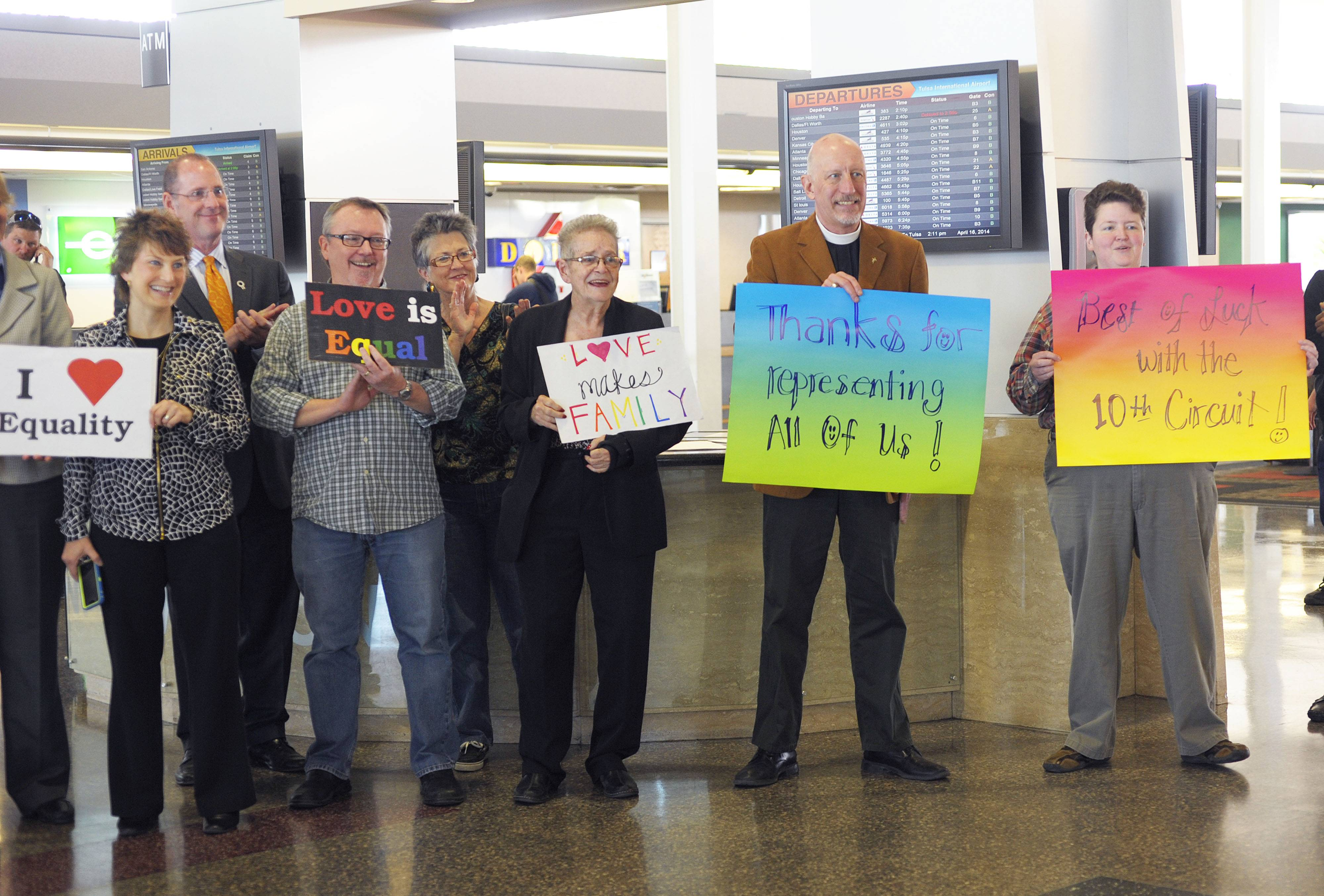 Oklahomans for Equality gather at Tulsa International Airport with their signs for a send off celebration in support for the plaintiffs in the Oklahoma Marriage Equality lawsuit as they head to the 10th Circuit Court of Appeals in Denver, Wednesday April 16, 2014.