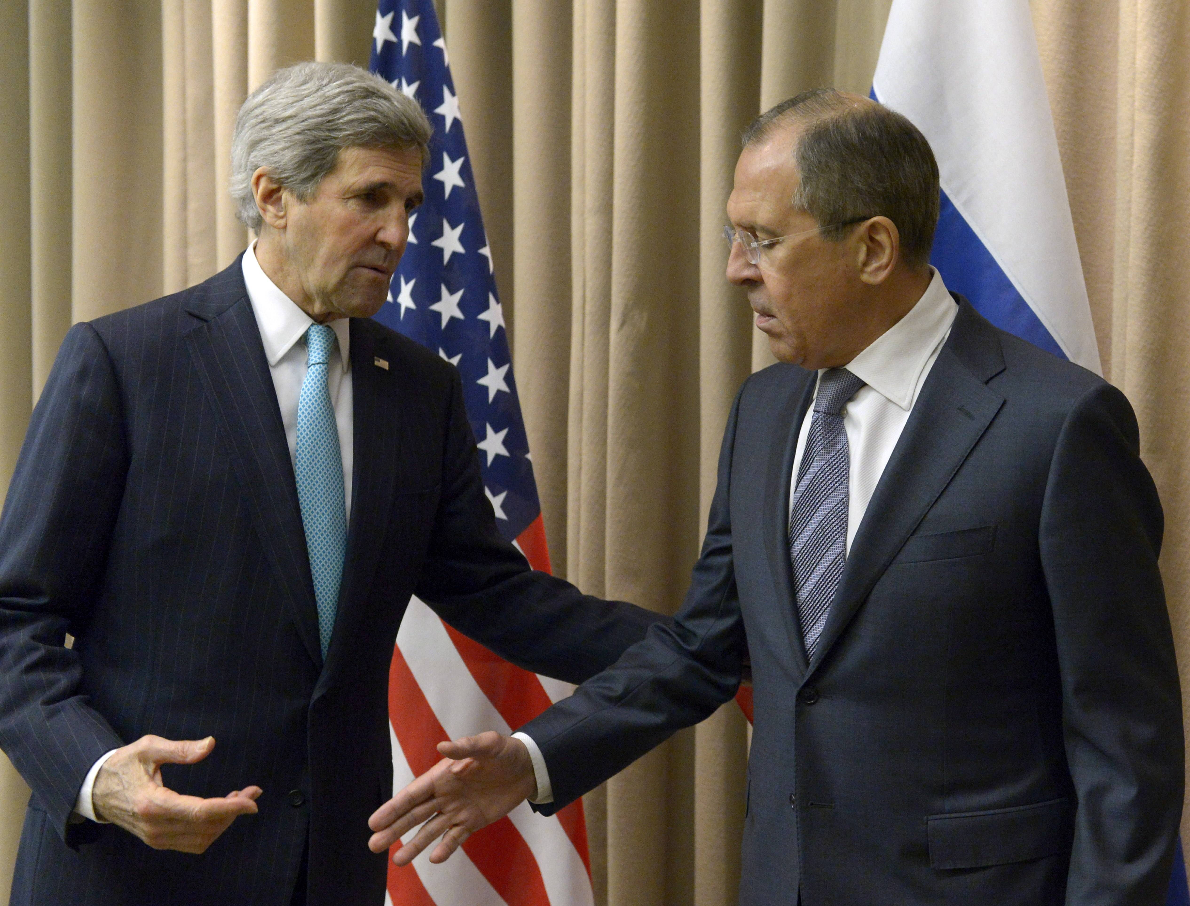 U.S. Secretary of State John Kerry, left, shakes hands Thursday with Russian Foreign Minister Sergey Lavrov before a bilateral meeting to discuss the ongoing situation in Ukraine as diplomats from the U.S., Ukraine, Russia and the European Union gather for discussions in Geneva. Ukraine is hoping to placate Russia and calm hostilities with its neighbor even as the U.S. prepares a new round of sanctions to punish Moscow for what it regards as fomenting unrest.