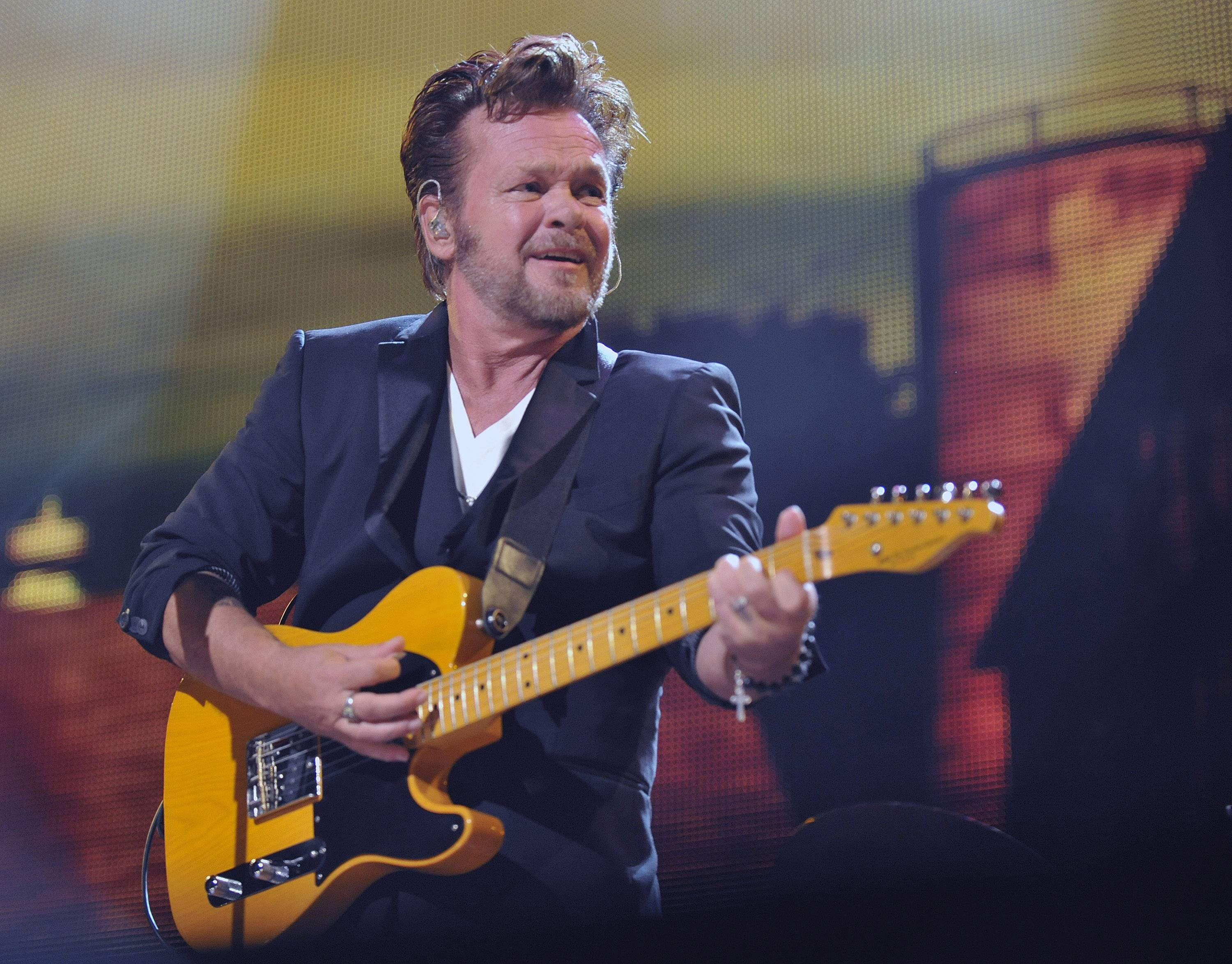 "John Mellencamp performs in Saratoga Springs, N.Y., in 2013. When Mellencamp caught wind of Wisconsin Gov. Soctt Walker playing ""Small Town"" during the recall campaign, his publicist sent Walker an email letting him know that Mellencamp supports collective bargaining and union rights."