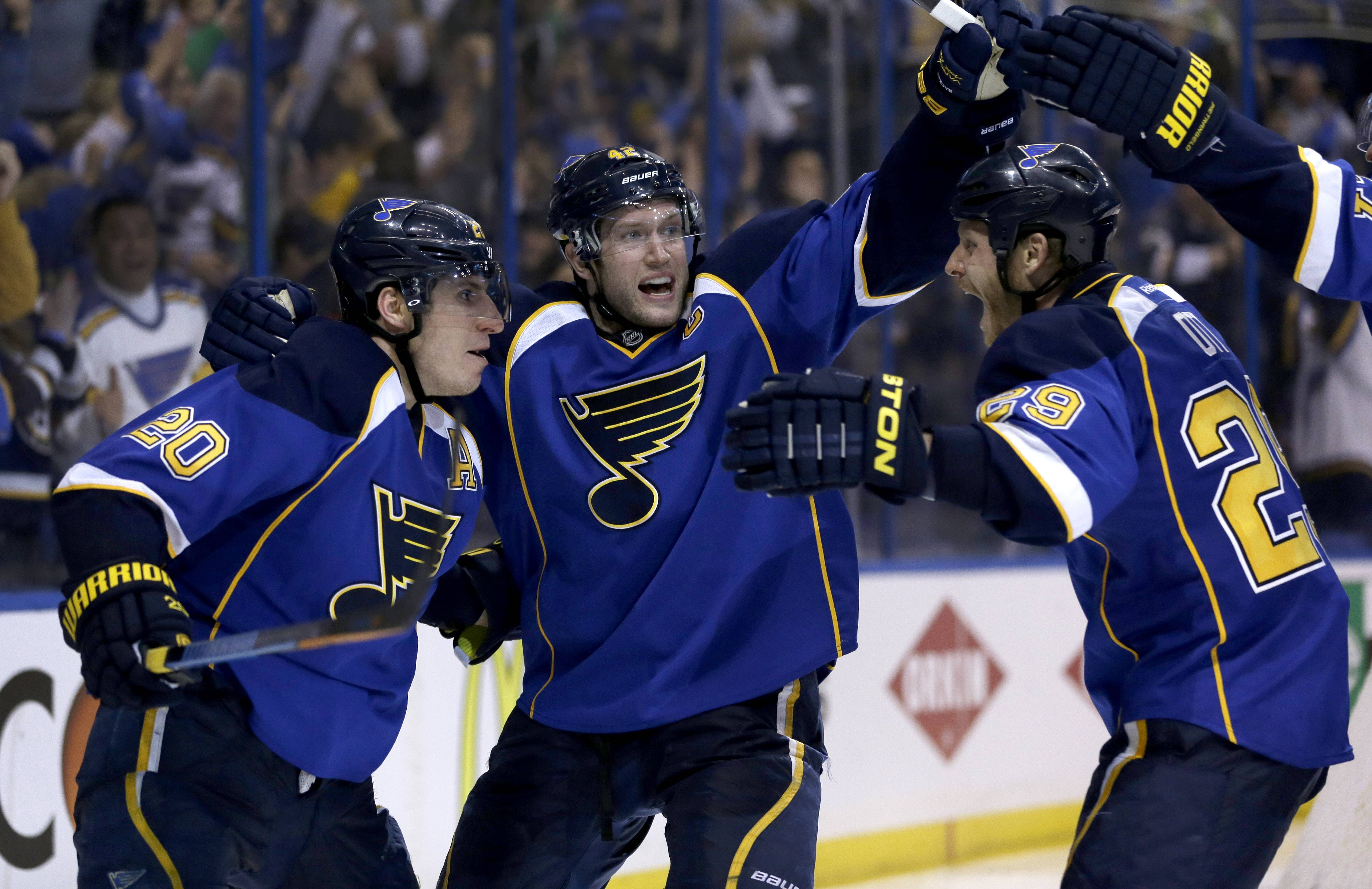 St. Louis Blues' Alexander Steen, left, is congratulated by teammates David Backes, center, and Steve Ott, right, after scoring the game-winning goal during the third overtime.