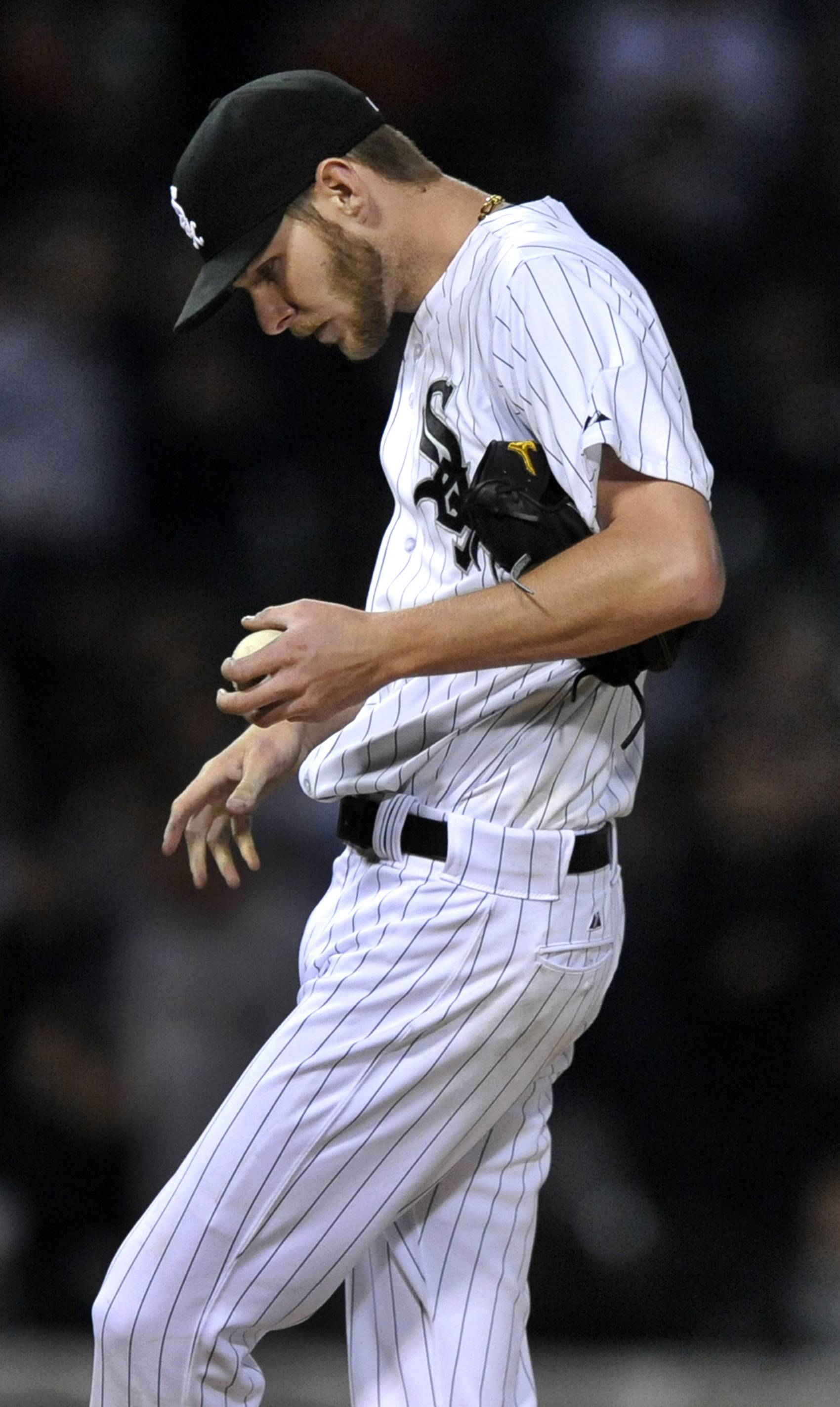 Chicago White Sox starting pitcher Chris Sale reacts to giving up a solo home run to Boston Red Sox's Xander Bogaerts during the sixth inning of a baseball game in Chicago, Thursday, April 17, 2014. (AP Photo/Paul Beaty)