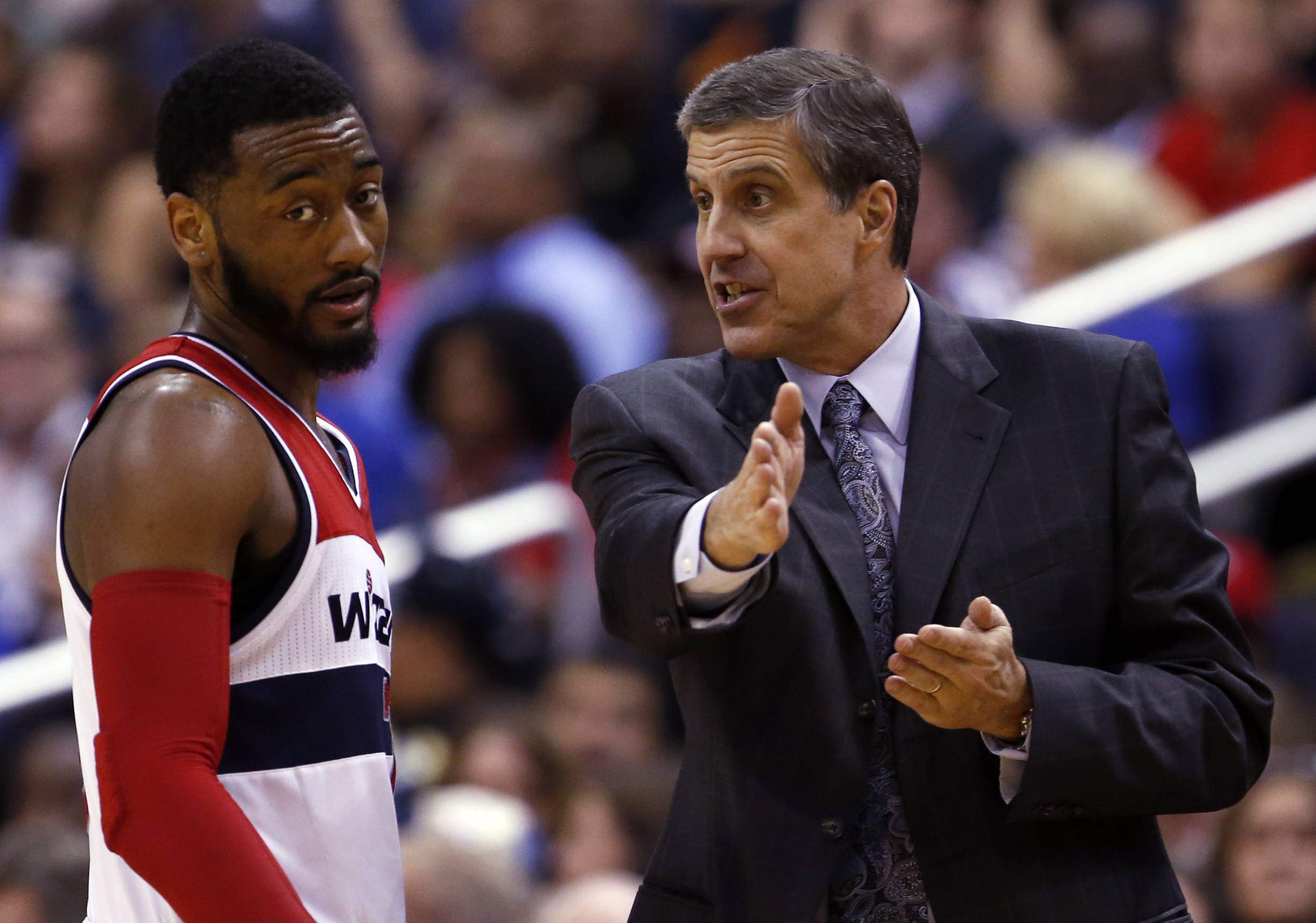 Washington Wizards guard John Wall listens to head coach Randy Wittman in a game against the Heat on April 14. Wall is averaging a team-best 19.3 points and 8.8 assists per game.