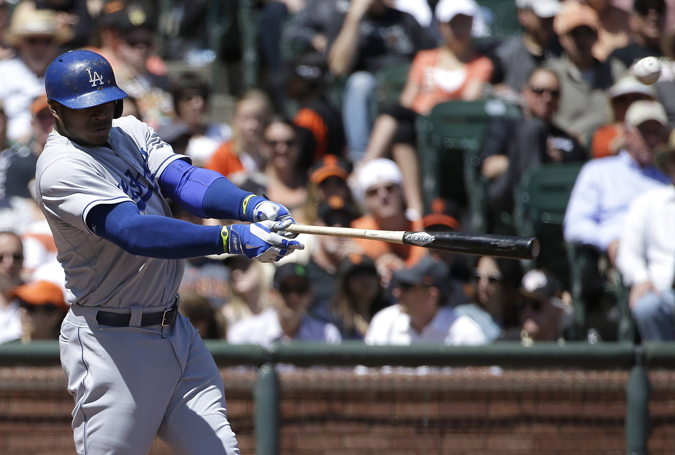 Los Angeles Dodgers' Yasiel Puig hits a single off San Francisco Giants pitcher Madison Bumgarner during the third inning of a baseball game in San Francisco, Thursday, April 17, 2014. The Dodgers won 2-1. (AP Photo/Jeff Chiu)