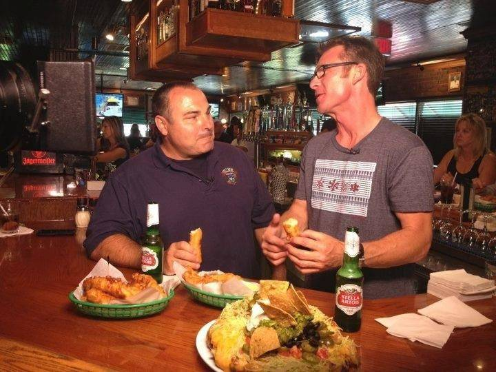 Village Tavern & Grill owner J.R. Hutson, left, chats with Ted Brunson at the restaurant in Schaumburg.