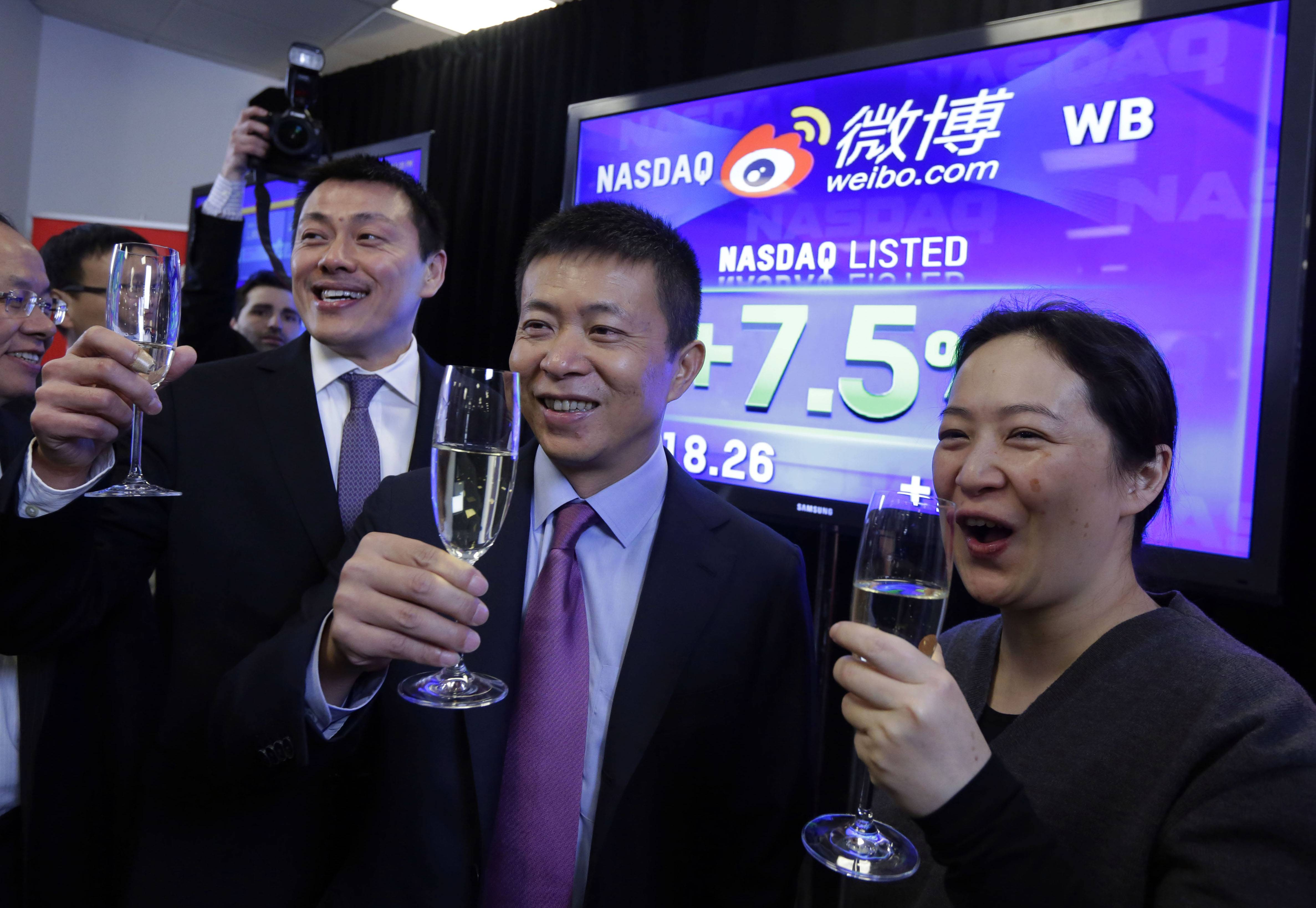 Weibo Corporation Chairman Charles Chao, center, is joined by company CFO Herman Yu, left, and Xiaoyin Zhang, of Goldman Sachs, as the Weibo's IPO begins trading, at the Nasdaq MarketSite, in New York, Thursday. Weibo provides a Twitter-like service that allows users to post up to 140 Chinese characters to share with others. Weibo has 61.4 million average daily active users, according to its filing with the SEC.