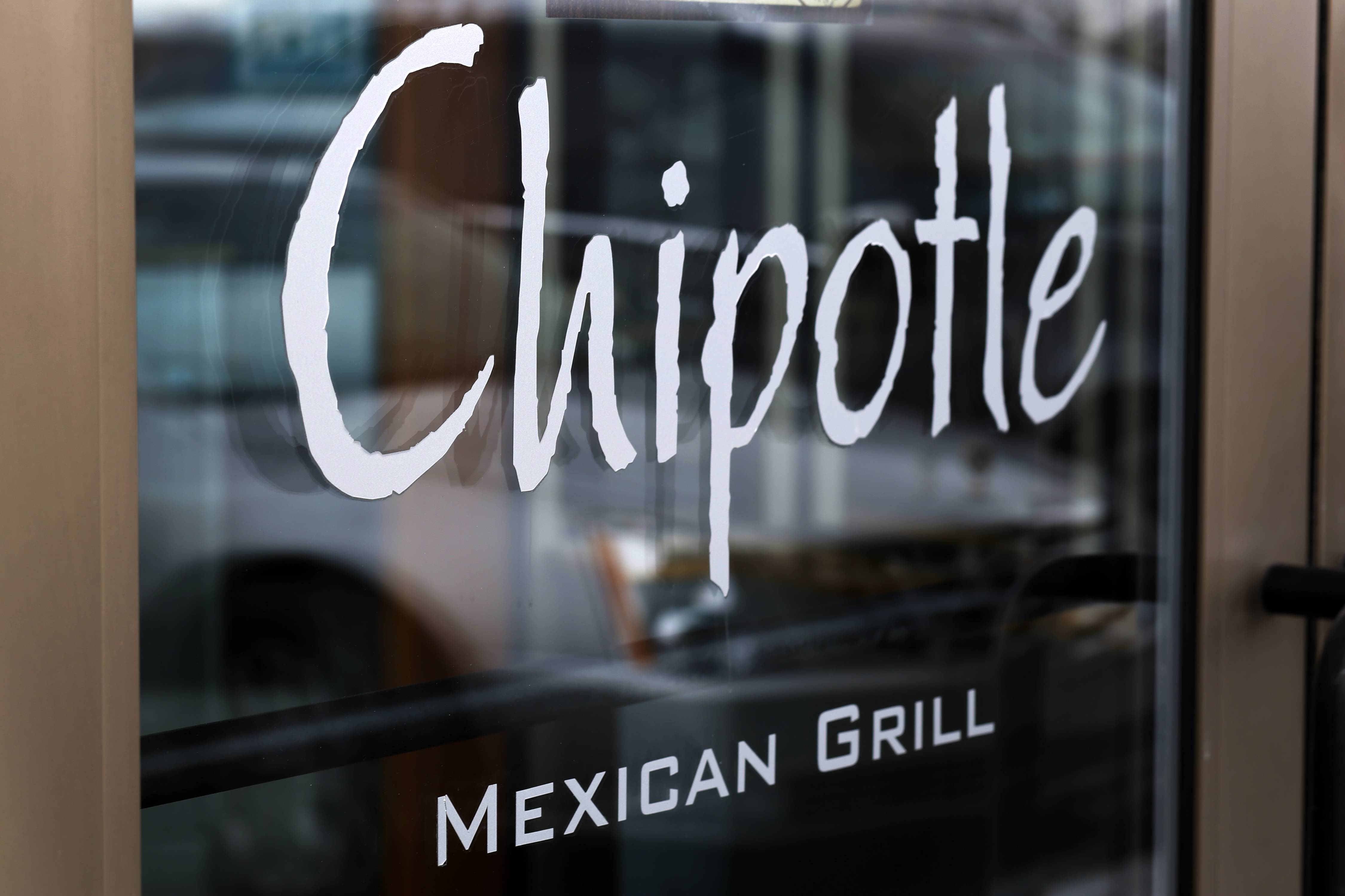 Mexican food chain Chipotle's first-quarter net income rose 8 percent as higher costs offset a sales surge as more customers bought its burritos and other fare.