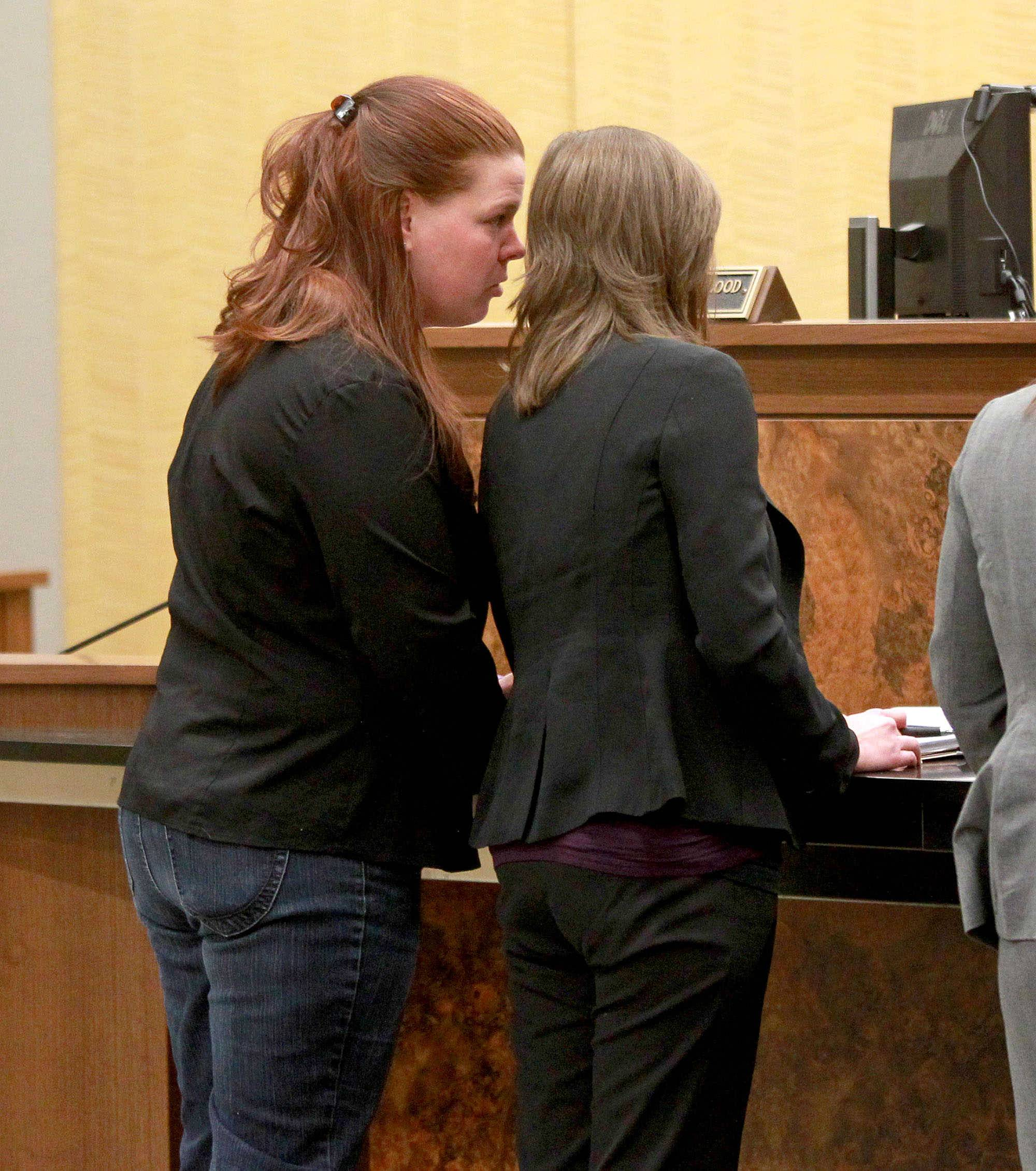 Stacy Fiebelkorn (far left) confers with her attorney, Alexis Costello, during an appearance before Kane County Associate Judge Elizabeth Flood at the Kane County Branch Court in St. Charles Thursday regarding a ruling on a gag order sought by Fiebelkorn's attorney to stop comments outside of court by county officials. Fiebelkorn has been charged with animal cruelty and neglect, two misdemeanor charges which are still pending.