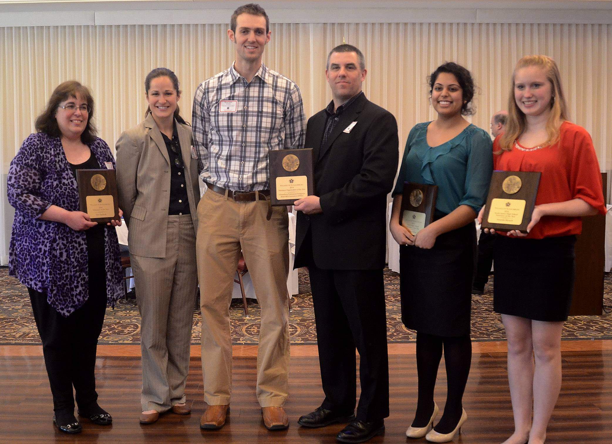 The 2014 Schaumburg Volunteer of the Year recipients from left, Adult Individual recipient Teri Dudasik; Organization recipients from the Schaumburg Professional Firefighters Benevolent Association, Jenna Werdell, Ryan Kelly and Jim Sheehan; and Youth recipients Sania Zaffar and Amanda Mytych.