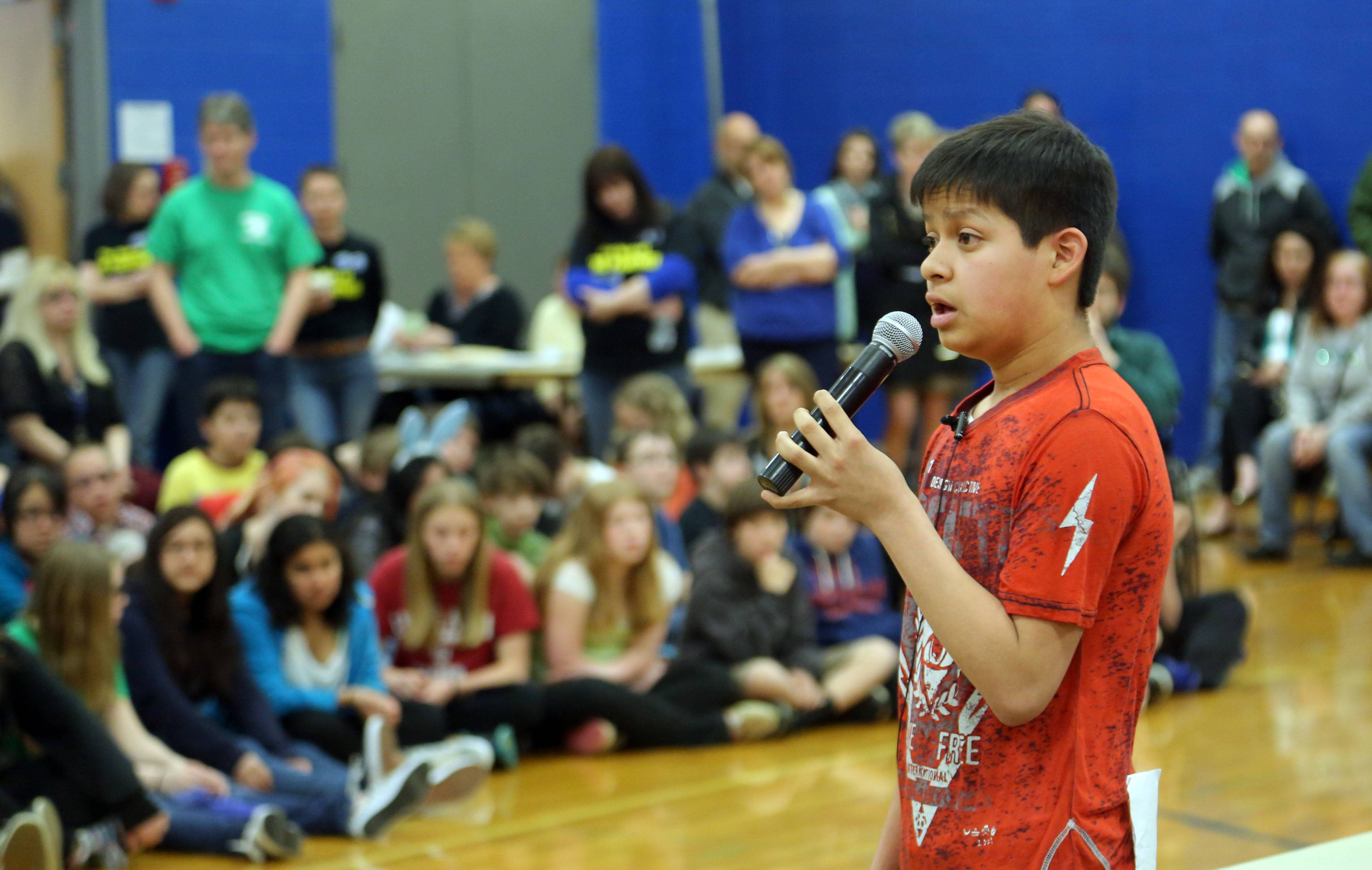Adrian Salvador, 13, shares his battle with cancer Thursday during a St. Baldrick's assembly at Grayslake Middle School.