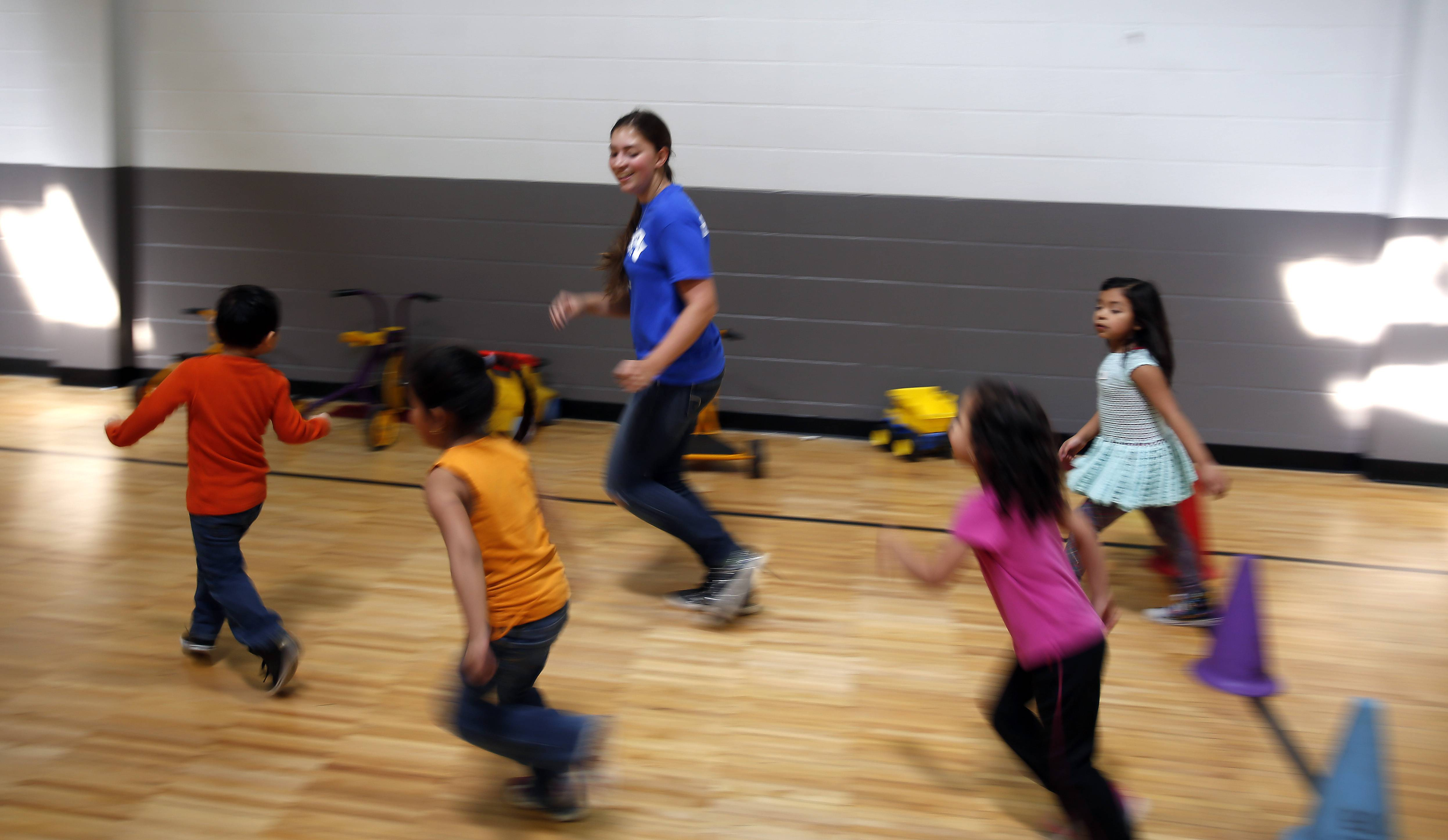 Gabrielle Grinnell, 14, a Westminster Christian School student, attempts to tire out a group of preschool children Thursday at the YWCA in Elgin. It was Westminster's second annual Give Back Day, where students and volunteers worked at different area locations to help out in any way they could.