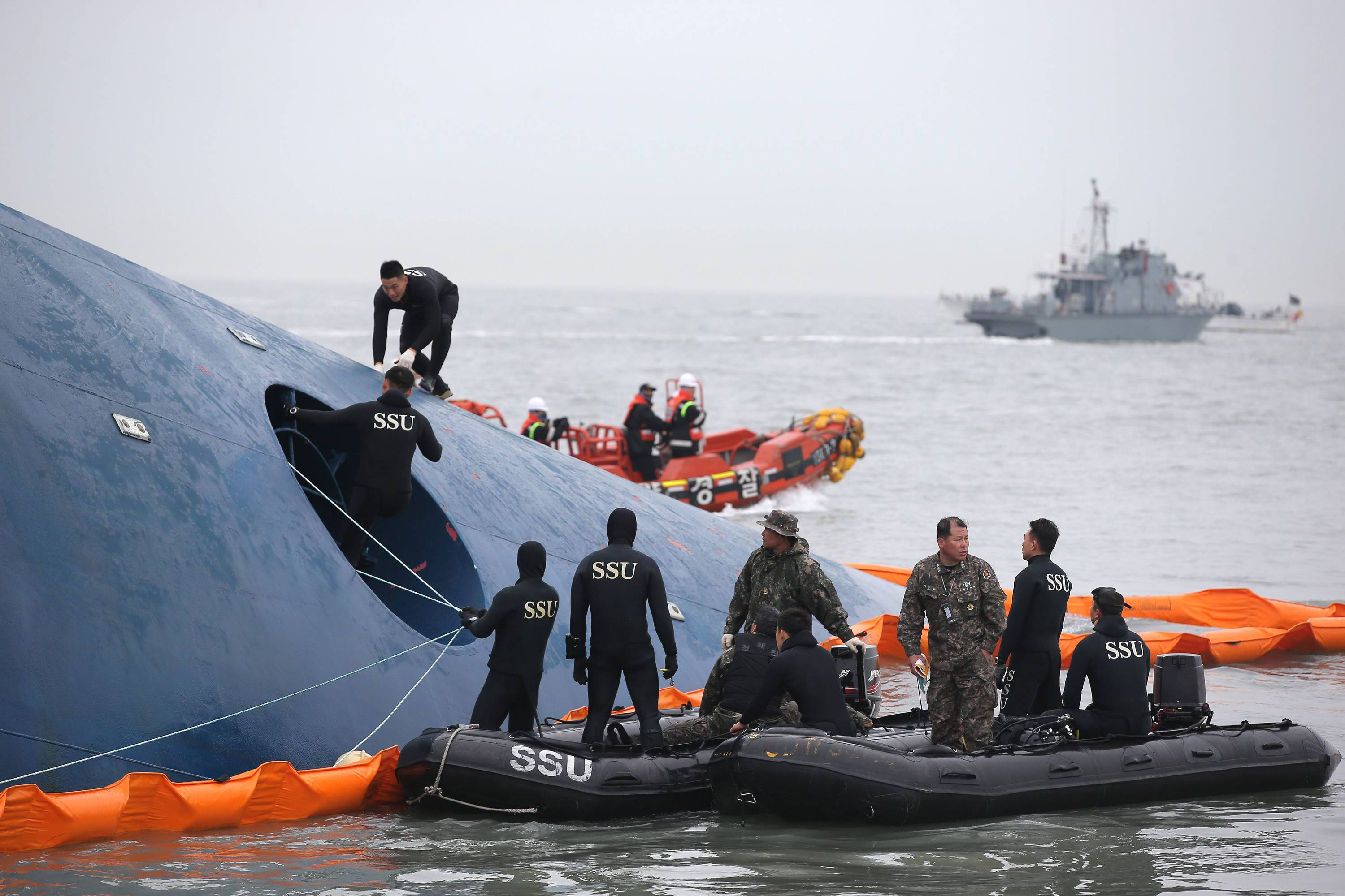 South Korean rescue team members search for passengers aboard a ferry sinking off South Korea's southern coast, in the water off the southern coast near Jindo, south of Seoul, South Korea, Thursday. Fears rose Thursday for the fate of more than 280 passengers still missing more than 24 hours after their ferry flipped onto its side and filled with water off the southern coast of South Korea.