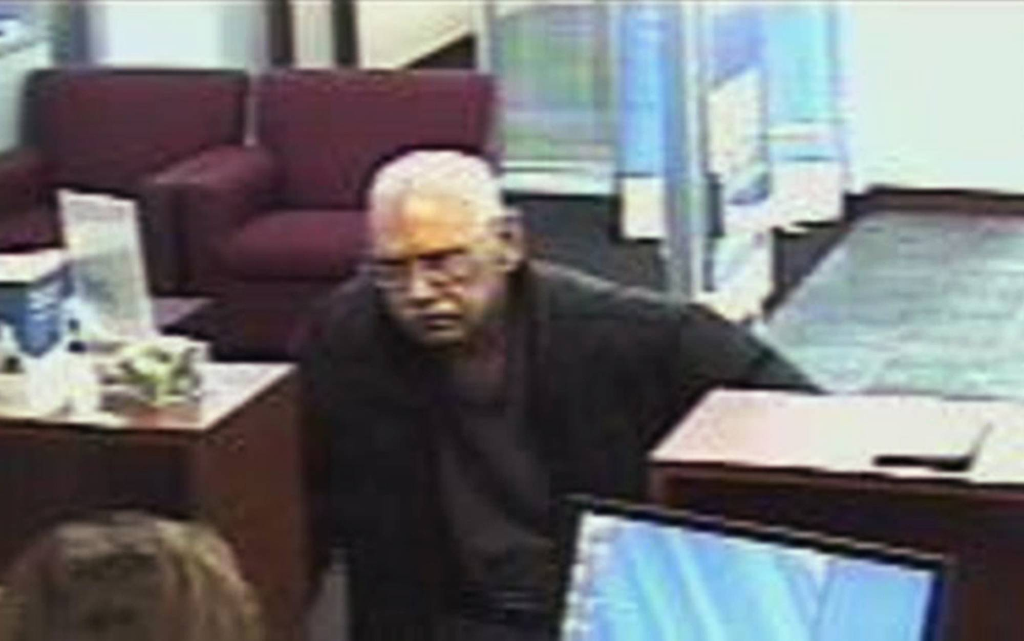 This image from a security video shows Walter Unbehaun robbing a bank in Niles in February 2013. The 73-year-old Unbehaun told investigators he intended to get caught so he could live his final years behind bars.