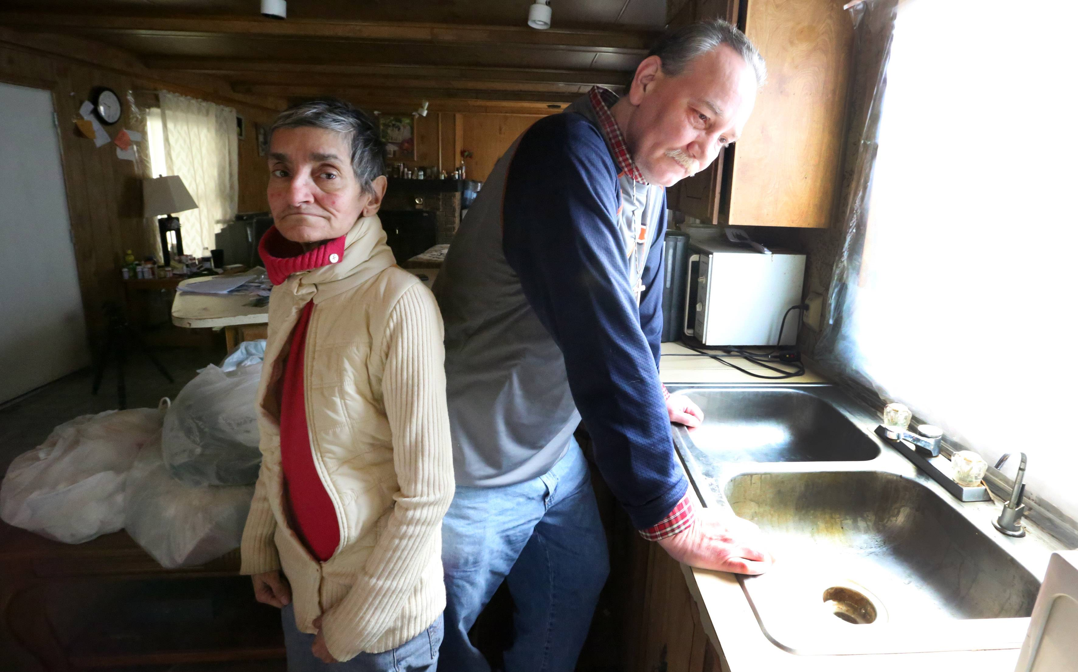 Michael Masalski and Marjorie Branly still live in their mobile home outside Des Plaines, a year after a record flood caused extensive damage.