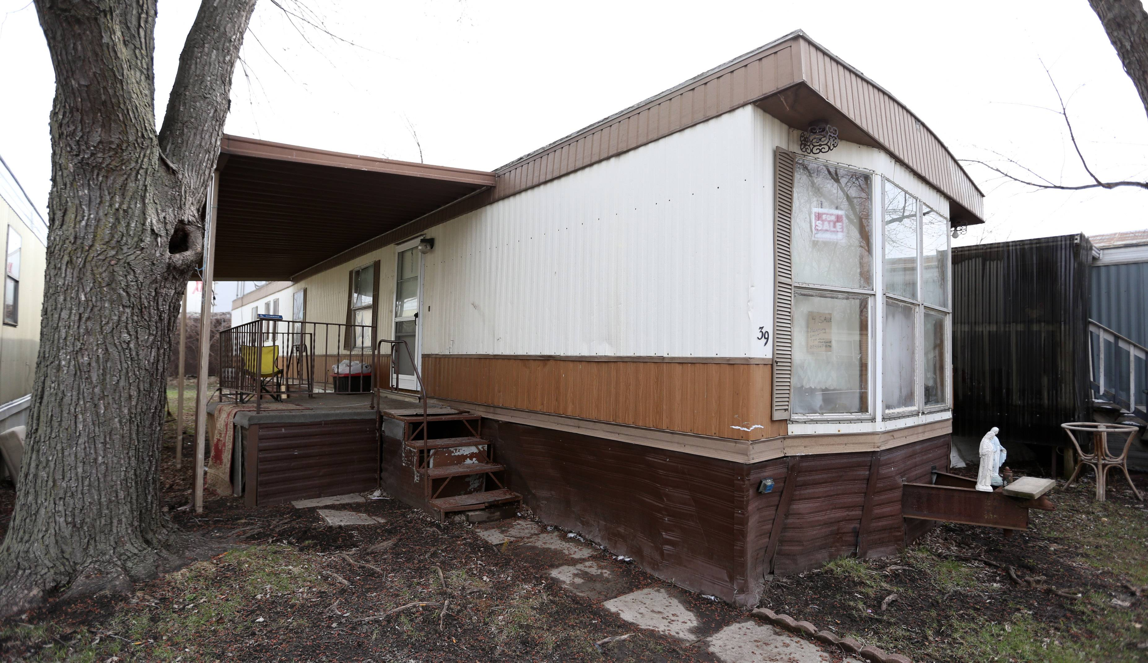 A year after nearly 6 inches of rain led to record flooding in and around Des Plaines, Michael Masalski and Marjorie Branly still live in this trailer with rotted floor boards and mold.