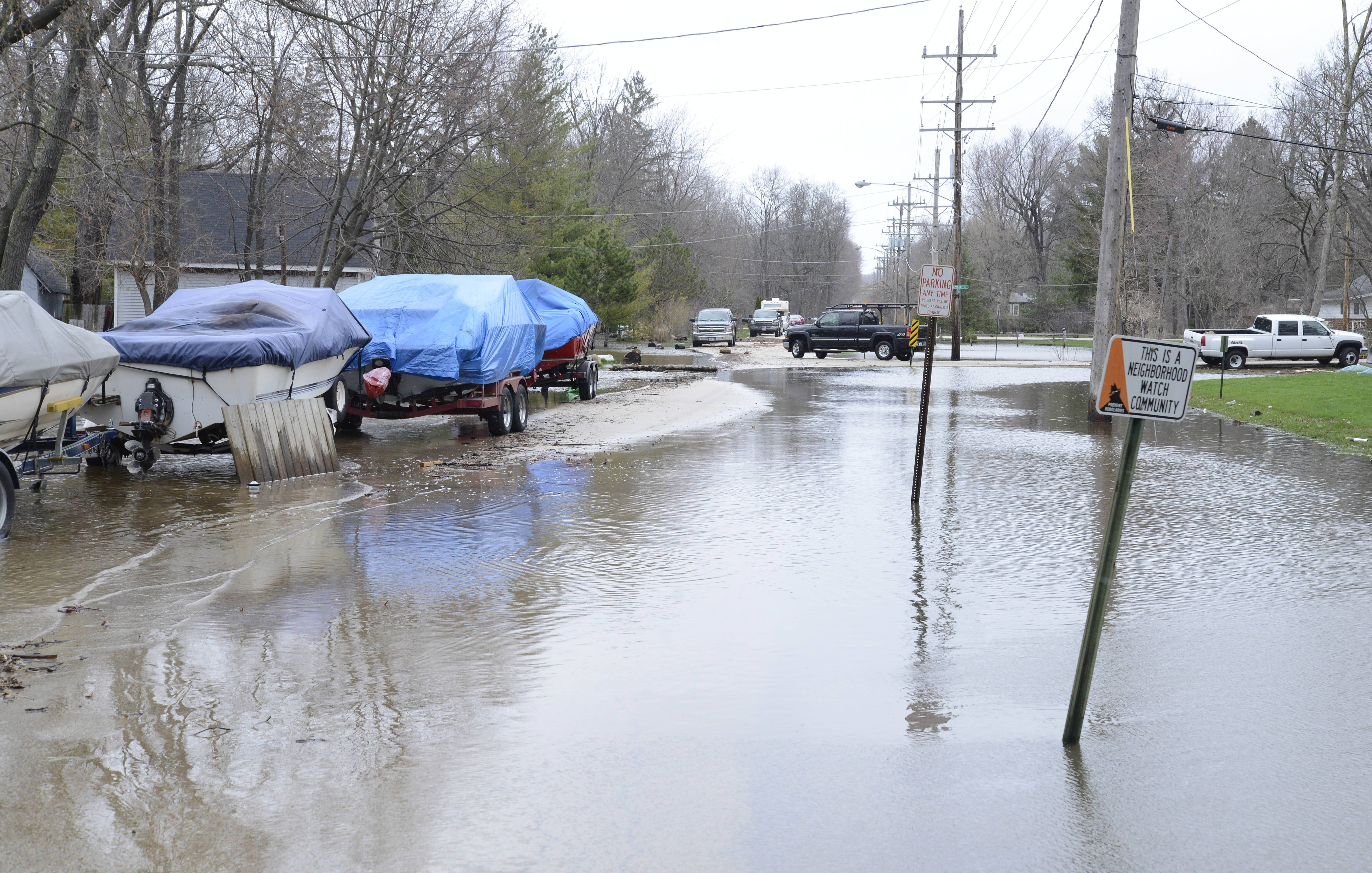 Floodwaters have receded since yesterday along Grove Ave in St. Charles Township on Friday, April 19. This neighborhood is on the east side of the river, just north of the Red Gate Bridge.
