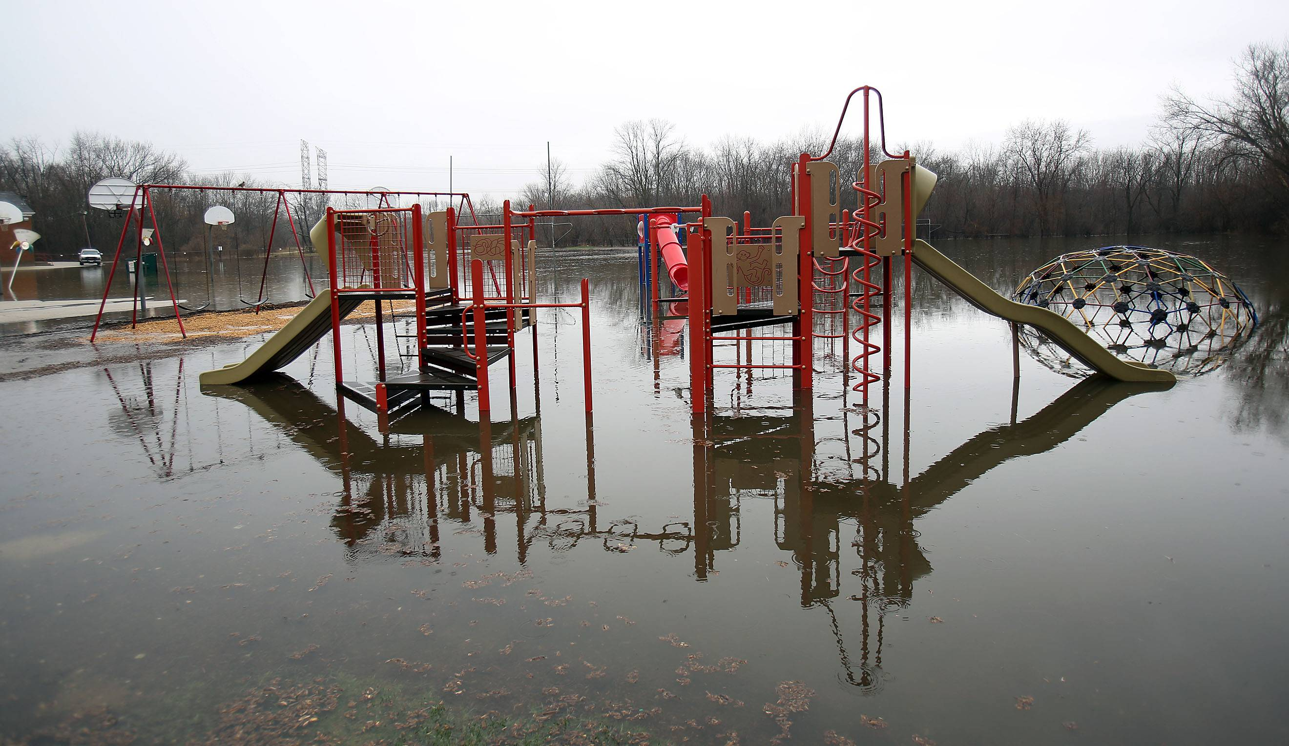 The playground behind Gurnee Grade School sits under water as the Des Plaines River over flows Thursday morning in Gurnee.