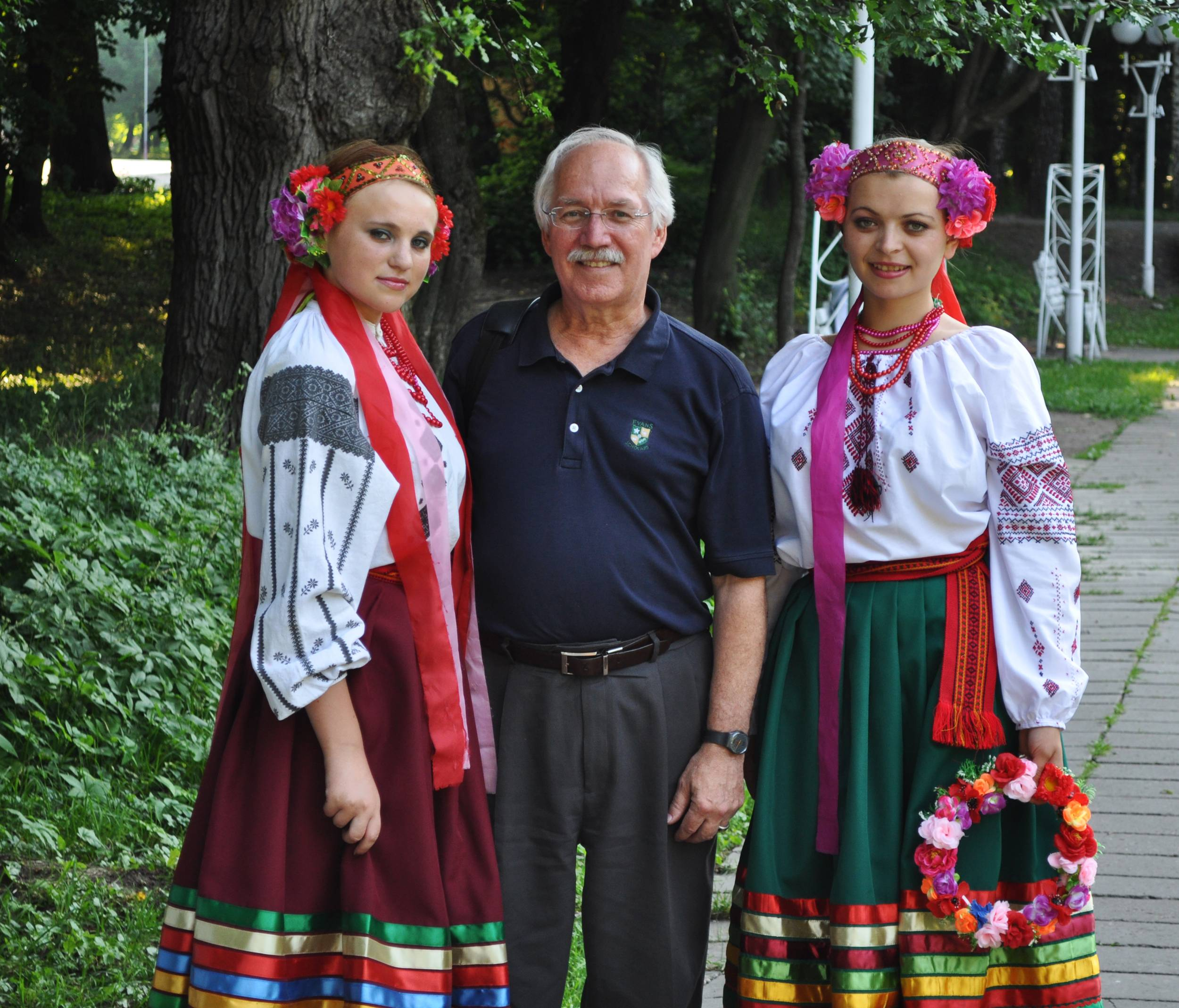 St. Charles Peace Corps volunteer Michael Dixon visits with two folk singers at a Ukrainian folk festival in Vinnytsia.