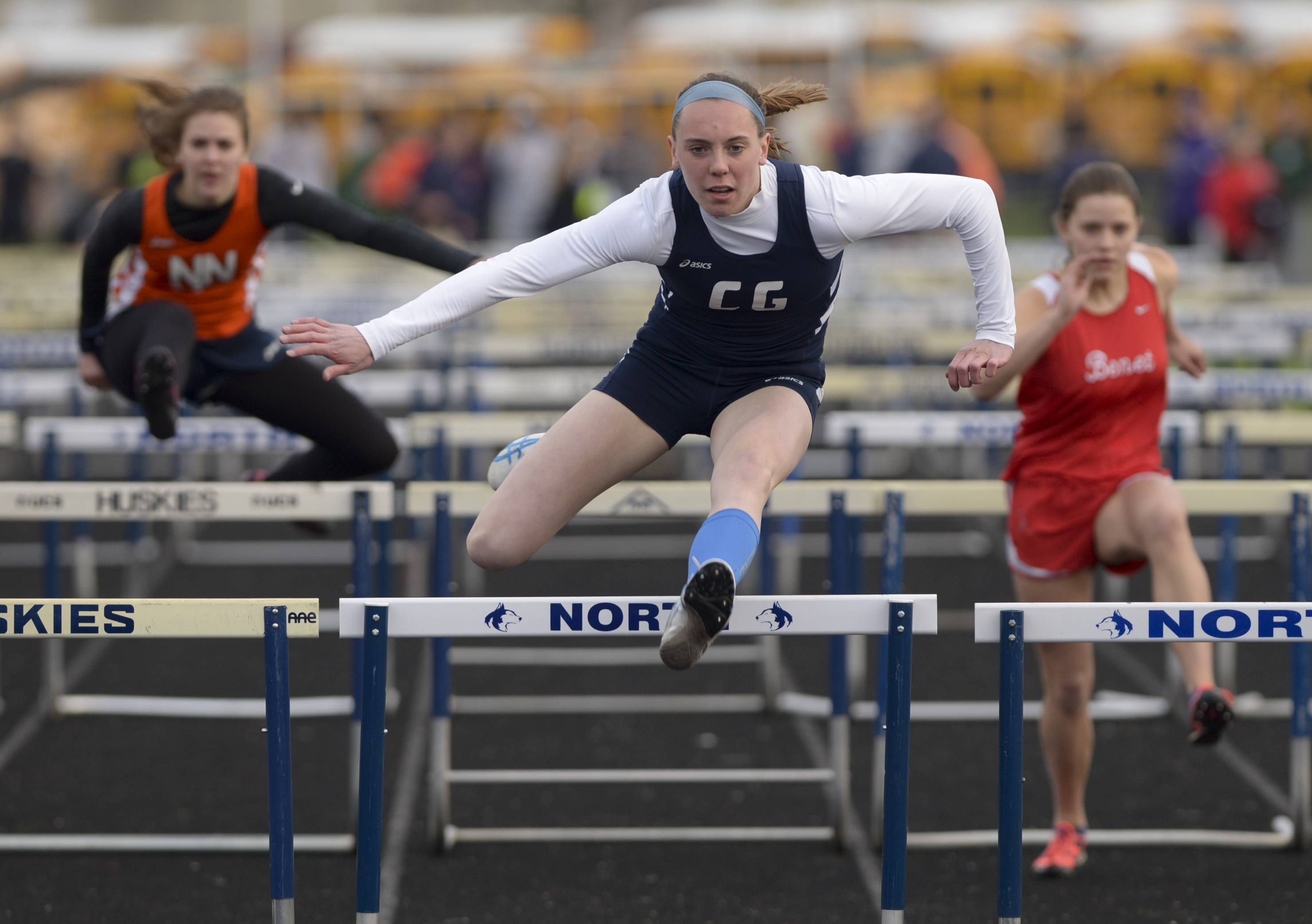 Cary Grove's Morgan Schulz competes in the 100-meter hurdles during the Gus Scott Track and Field Invitational at Naperville North Thursday.