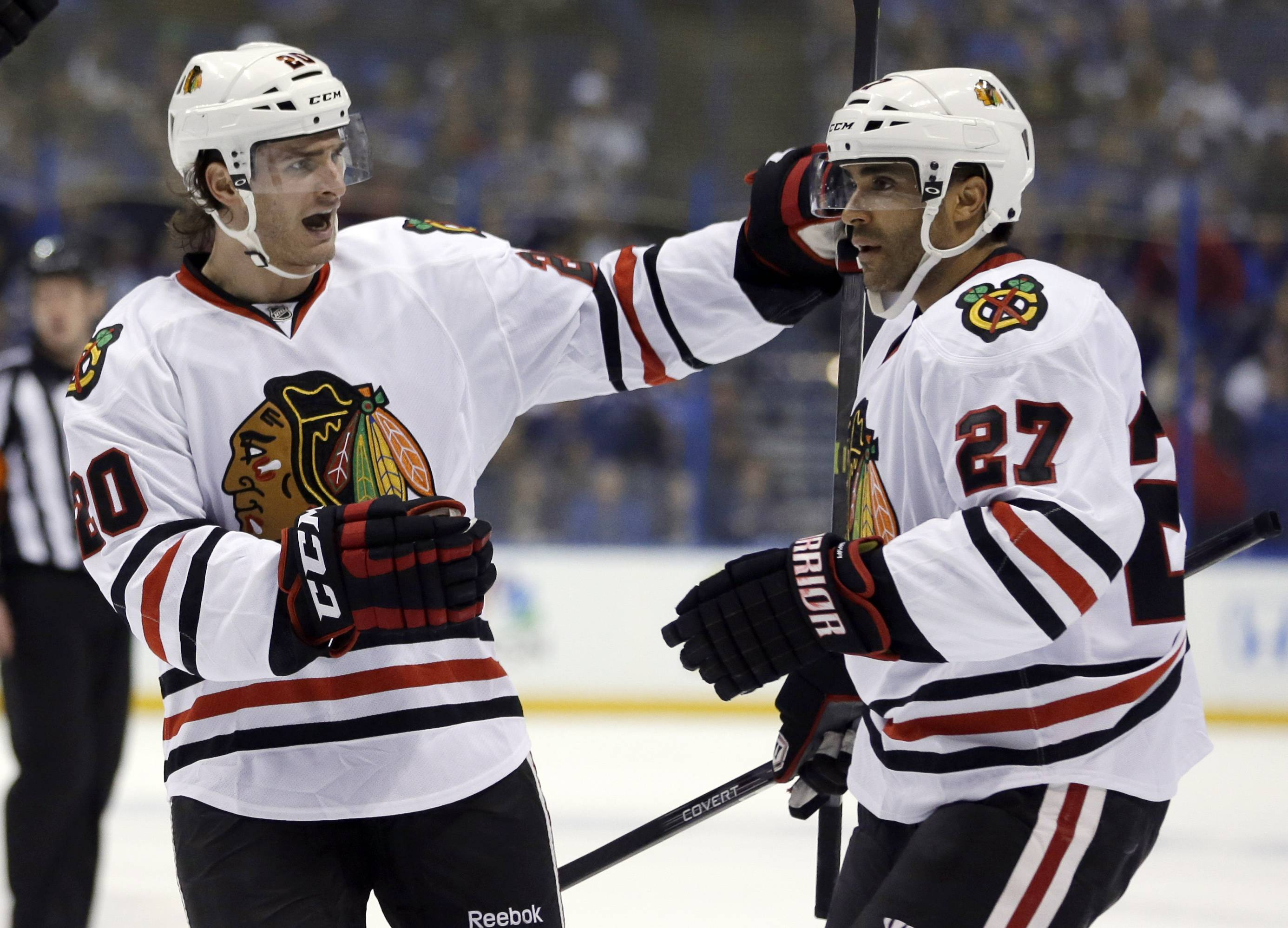Chicago Blackhawks' Johnny Oduya, of Sweden, is congratulated by Brandon Saad, left, after scoring during the first period .