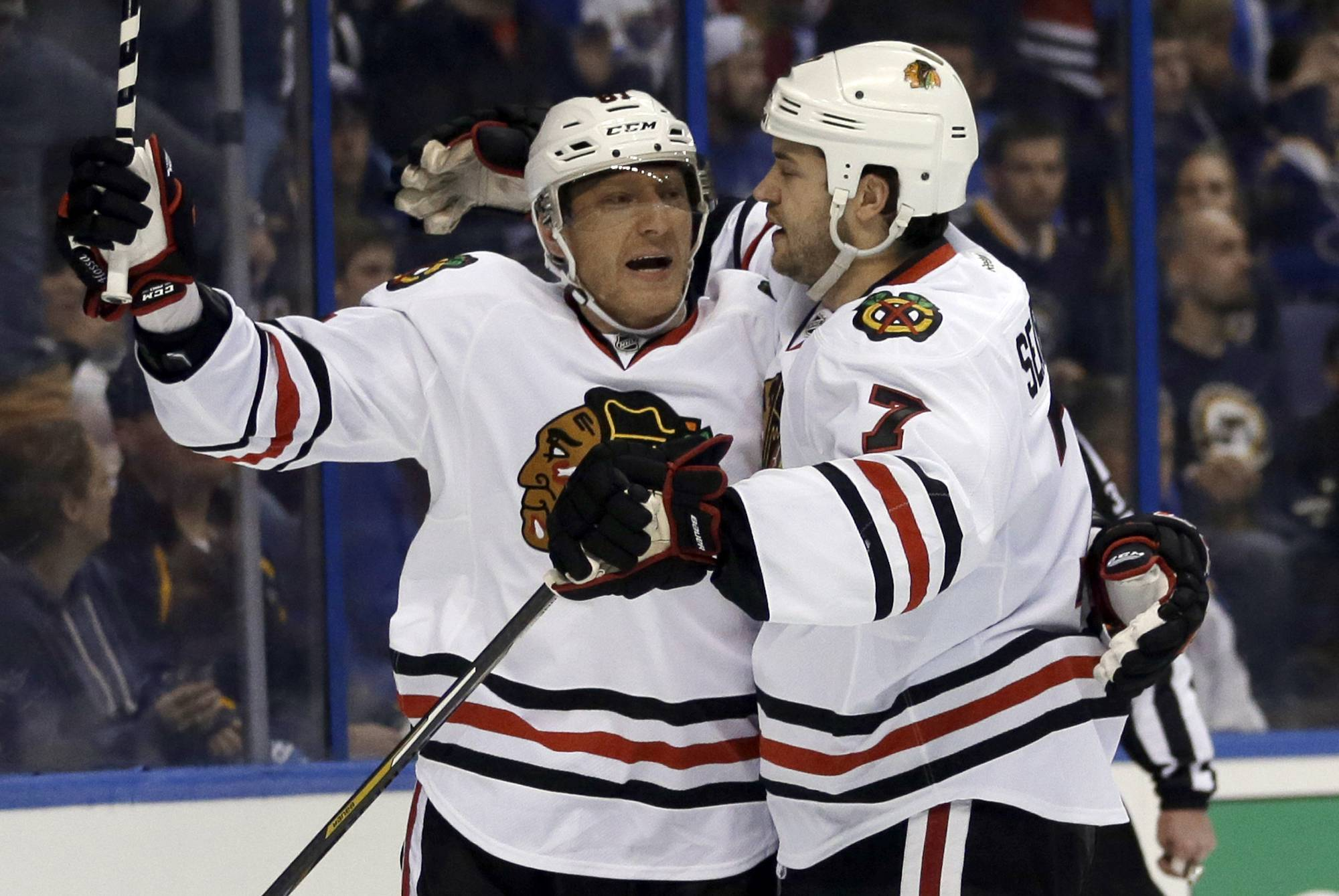 Chicago Blackhawks' Brent Seabrook, right, is congratulated by Marian Hossa after scoring during the first period.