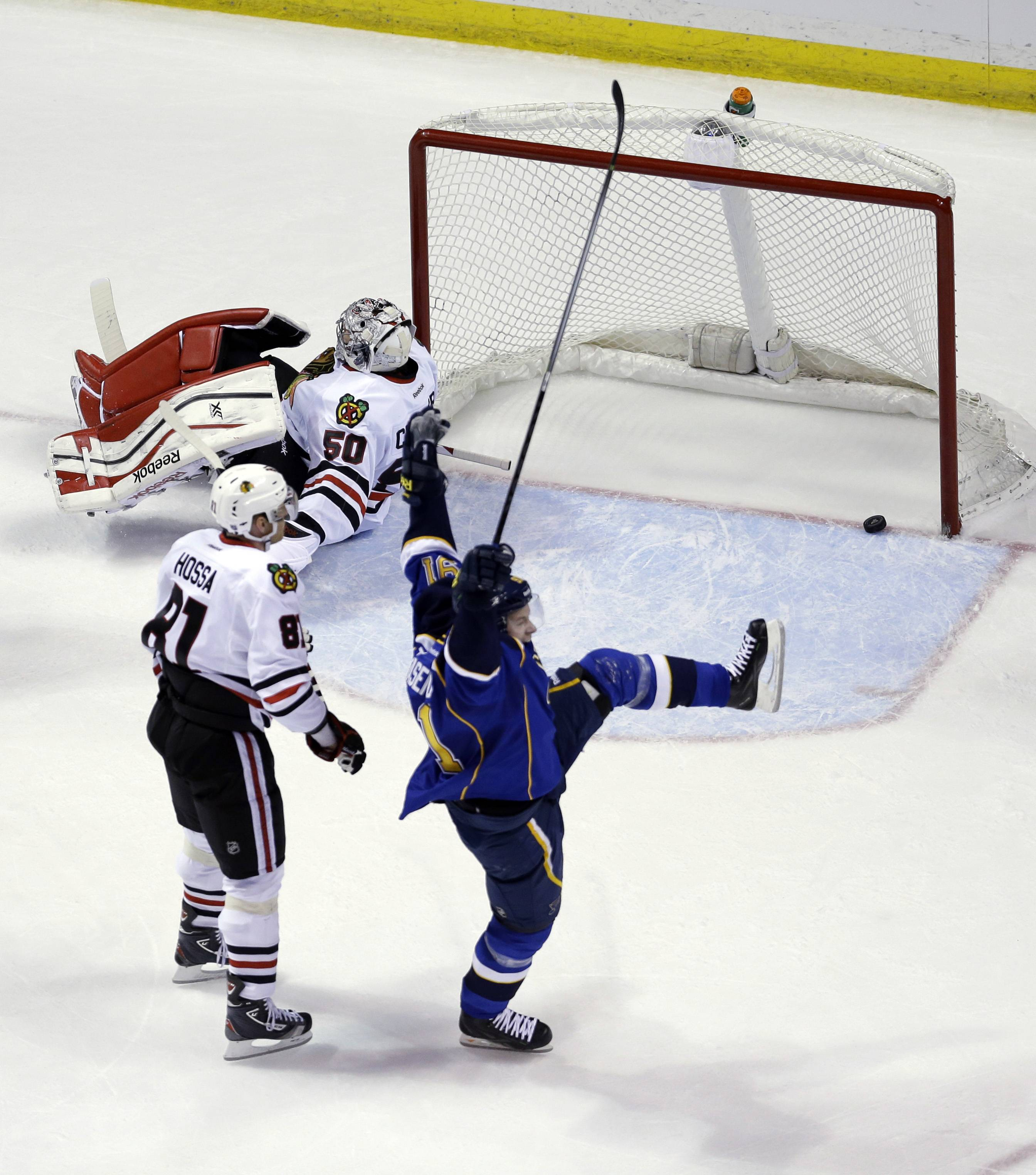 St. Louis Blues' Vladimir Tarasenko, of Russia, celebrates after scoring past Chicago Blackhawks goalie Corey Crawford (50) and Marian Hossa (81) during the first period.