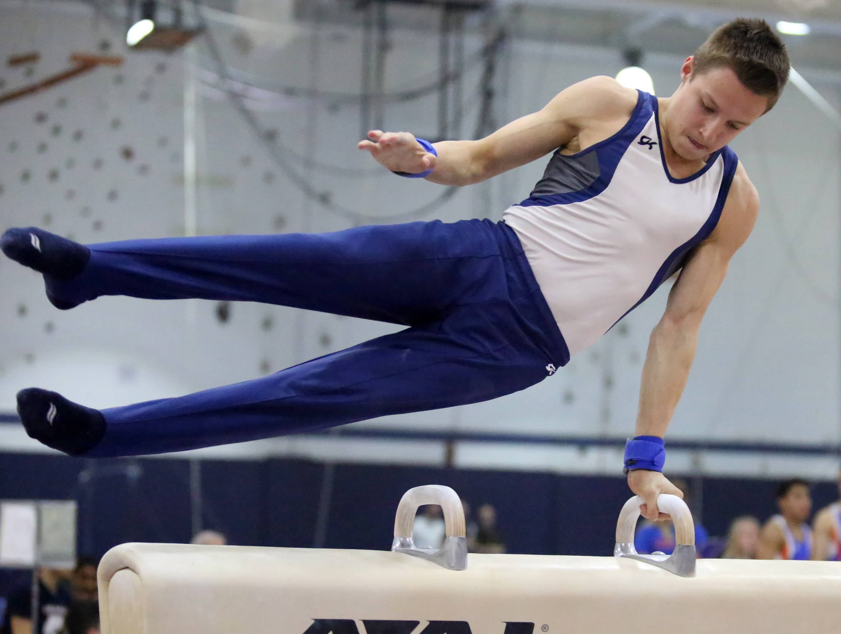 Prospect's Max Andryushchenko on the pommel horse at Conant on Thursday in Hoffman Estates.