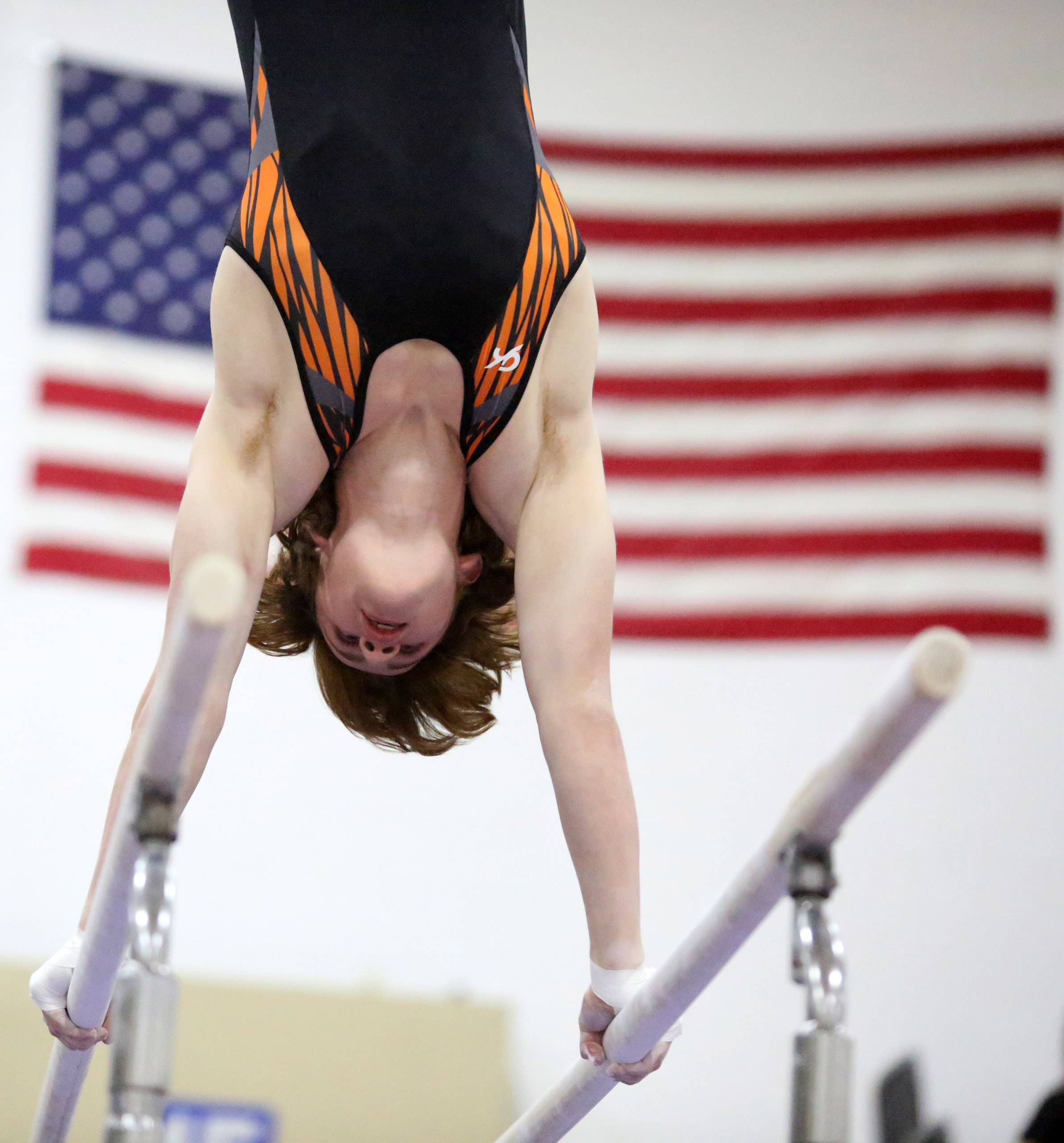 Libertyville's Ben Reichert on the parallel bars at Conant on Thursday in Hoffman Estates.