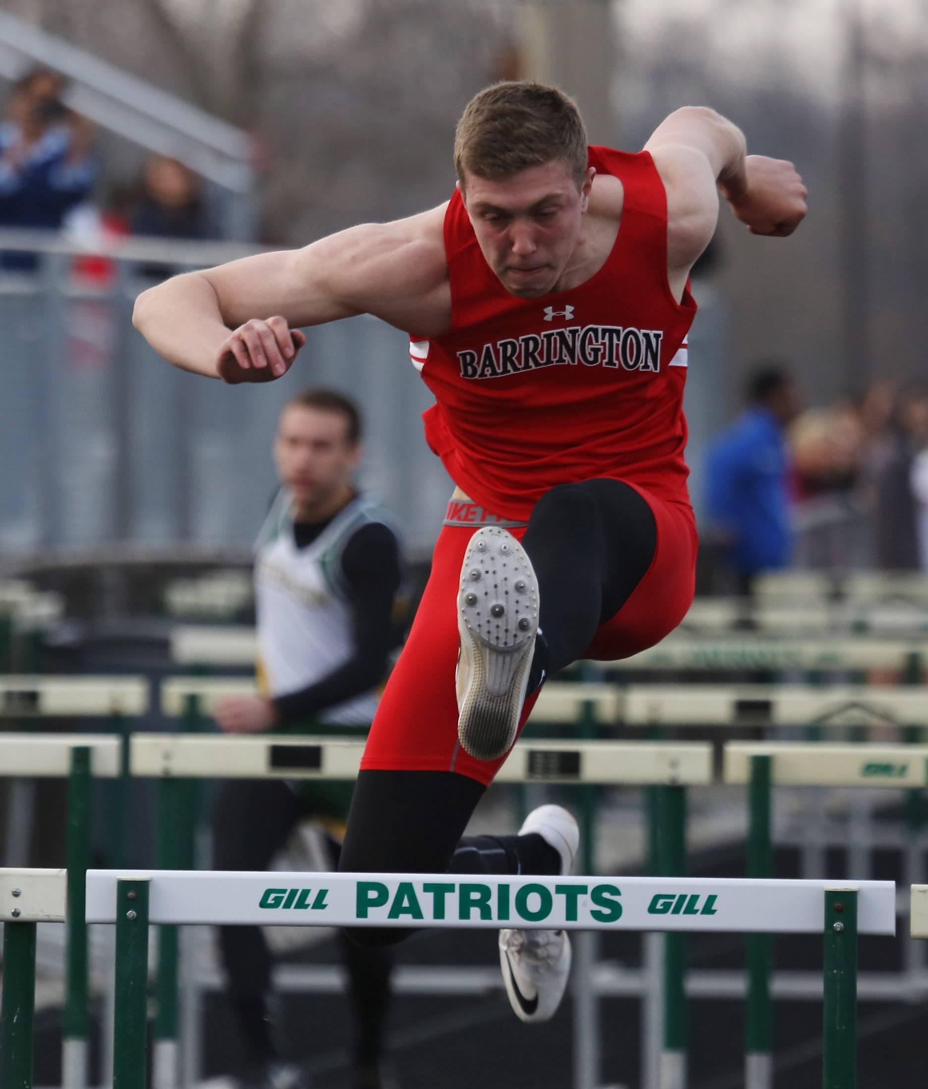 Barrington hurdler Parker Deloye competes in the high hurdles relay during the 43rd Annual Patriot Relays Thursday at Stevenson.