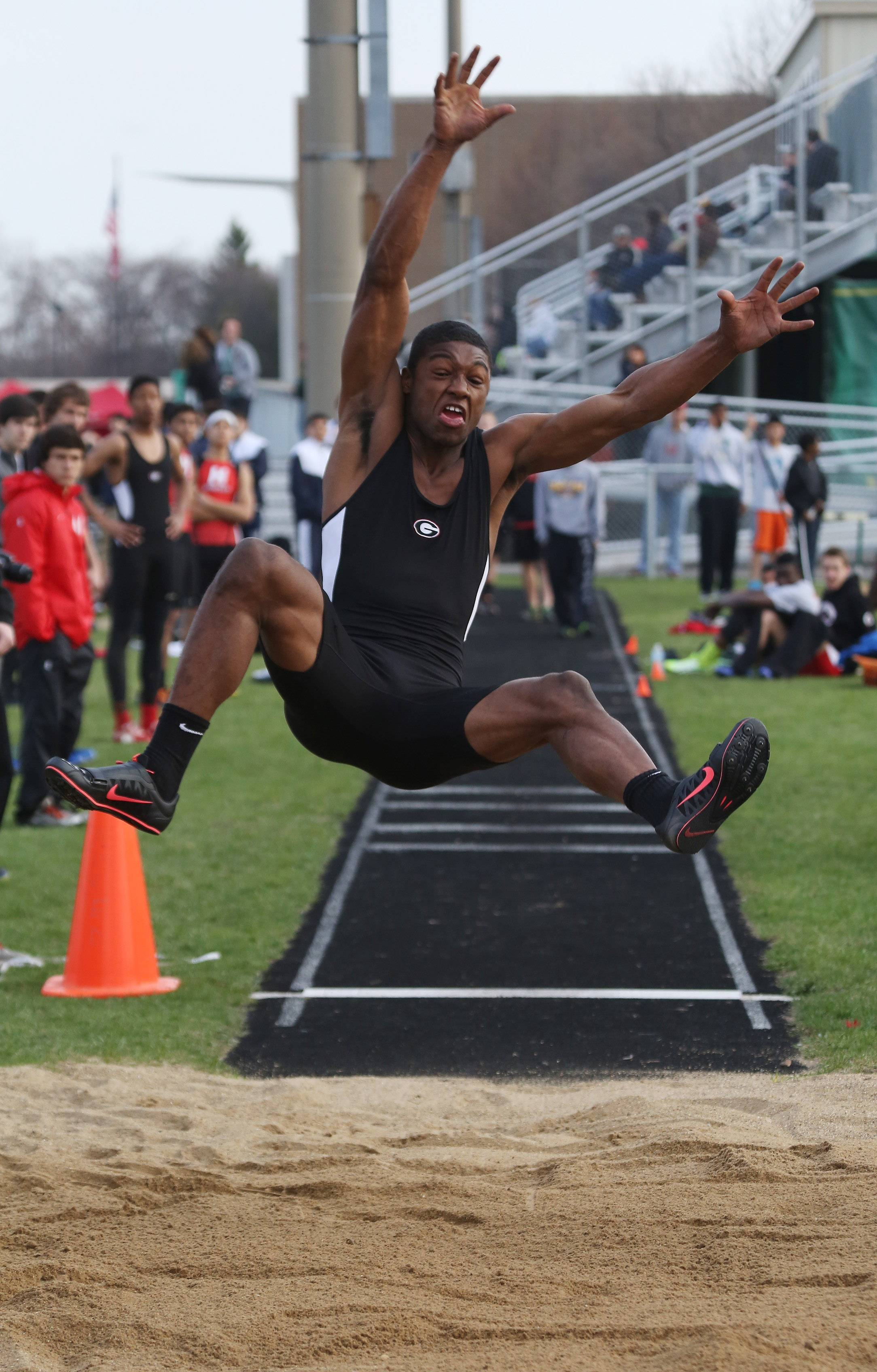 Grant jumper Jonathan Wells stretches out in the long jump during the 43rd Annual Stevenson Patriot Relays Thursday at Stevenson.