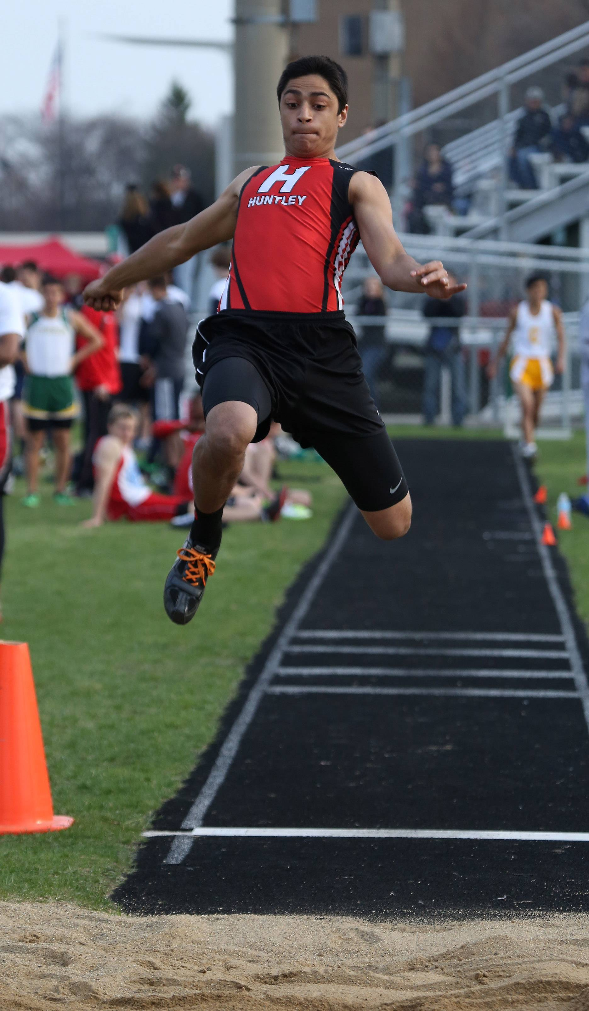 Huntley jumper Sean Patel in the long jump during the 43rd Annual Patriot Relays on Thursday at Stevenson.