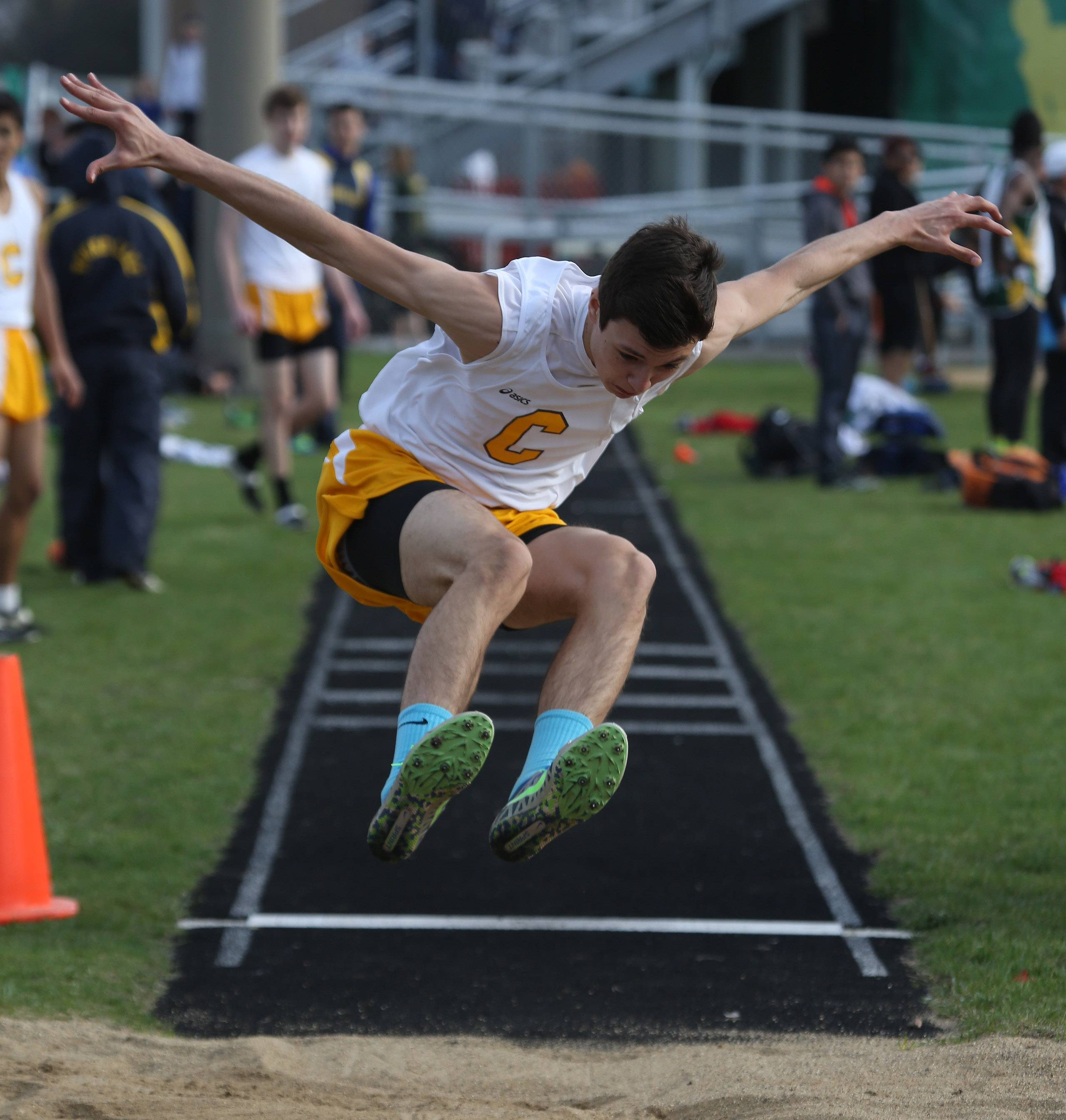 Carmel jumper Patrick Foster during the 43rd Annual Patriot Relays on Thursday at Stevenson.