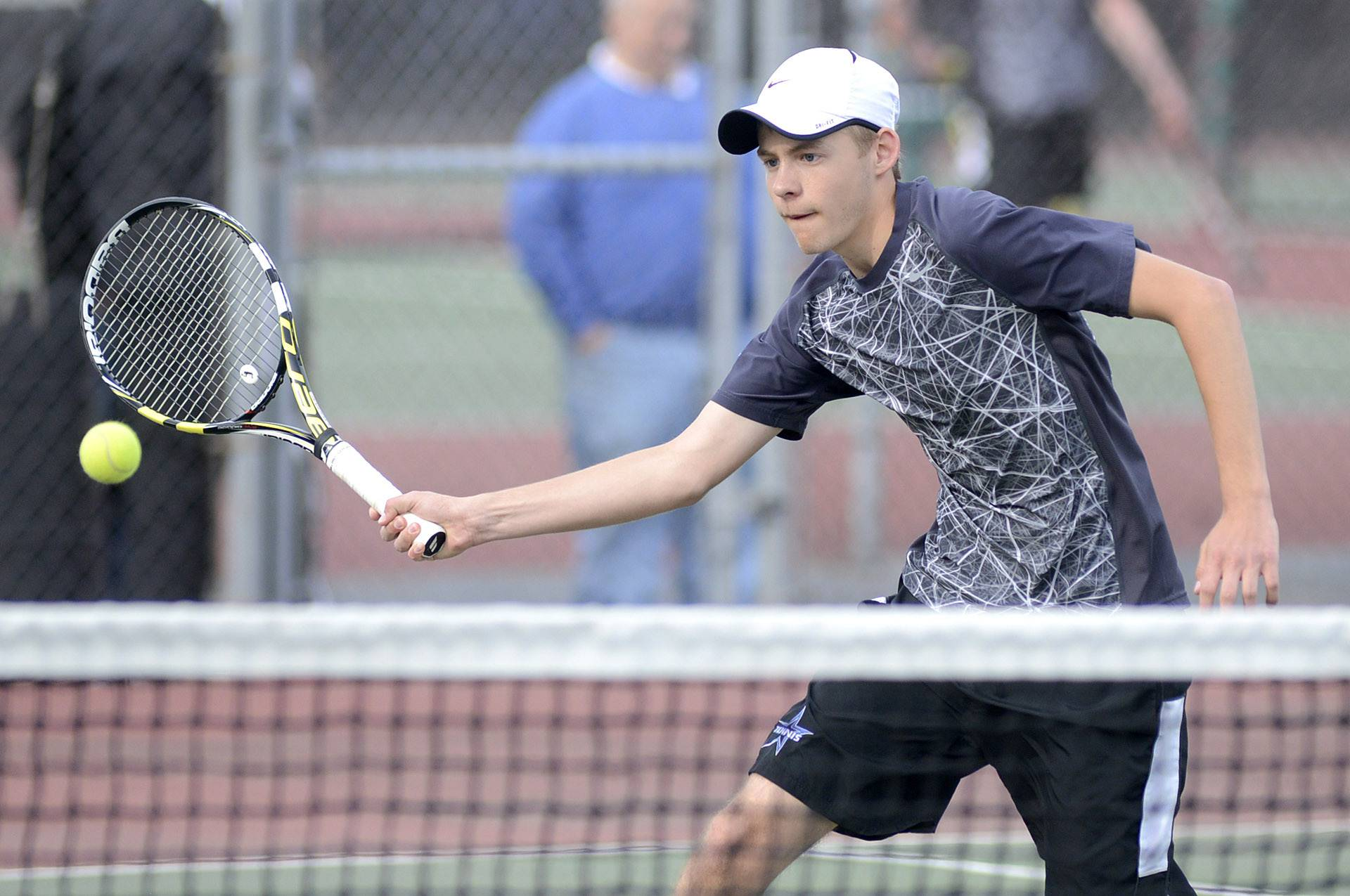 St. Charles North's Aaron Amburgey in the first doubles match vs. St. Charles East on Thursday, April 17.