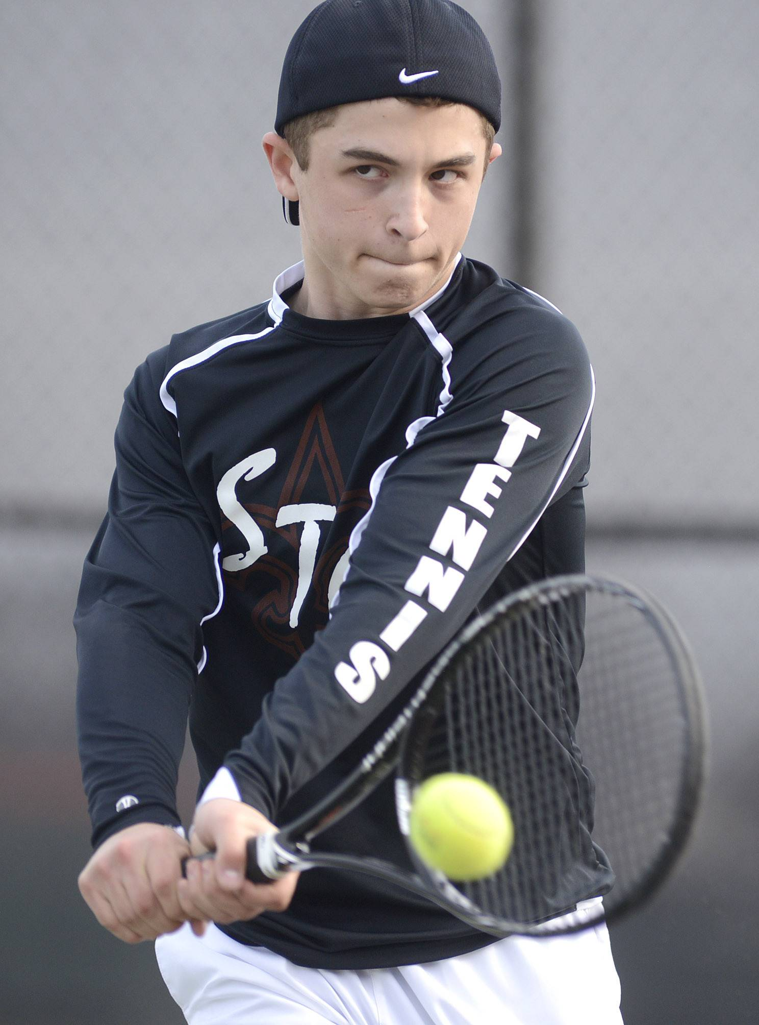 St. Charles East's Alex Winters returns a serve from St. Charles North in the first doubles match on Thursday, April 17.