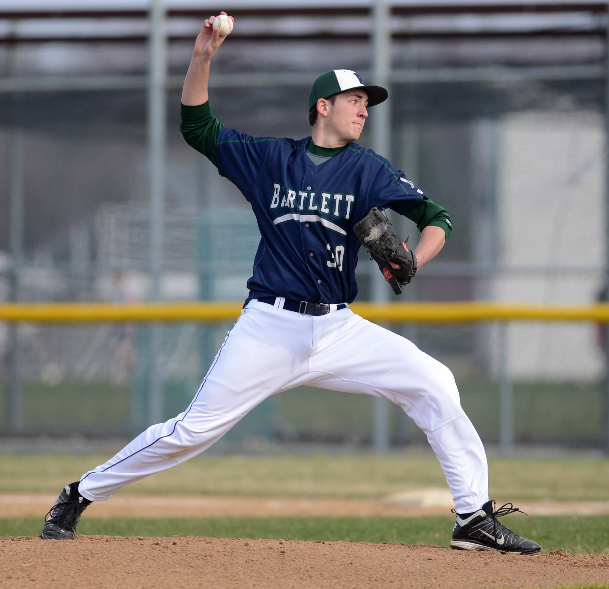 Bartlett's Alex Curtis delivers a pitch to a Streamwood batter during Thursday's game in Bartlett.