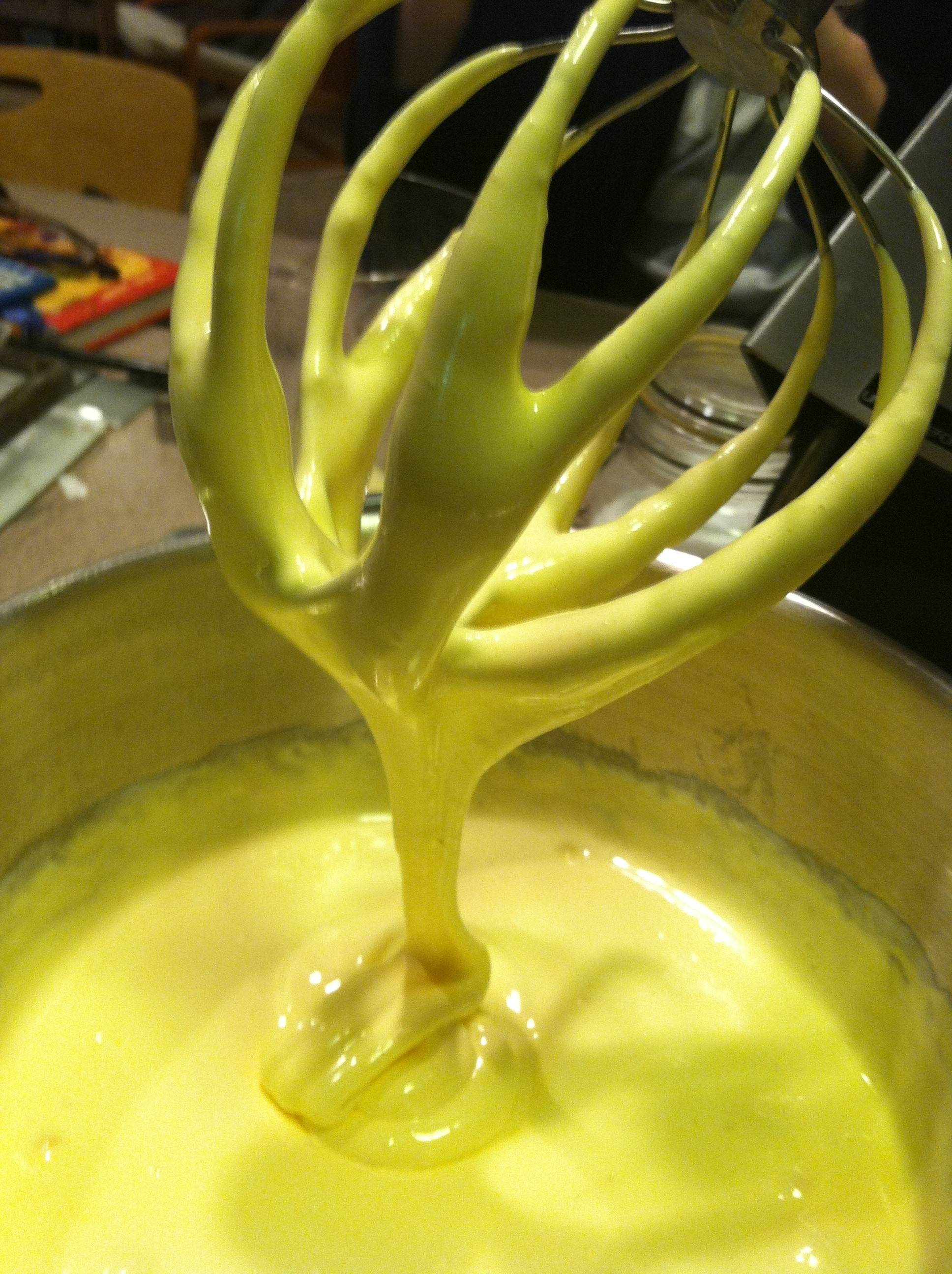 The gelatin-sugar mixture is ready when thick ribbons slowly flow off the beater.