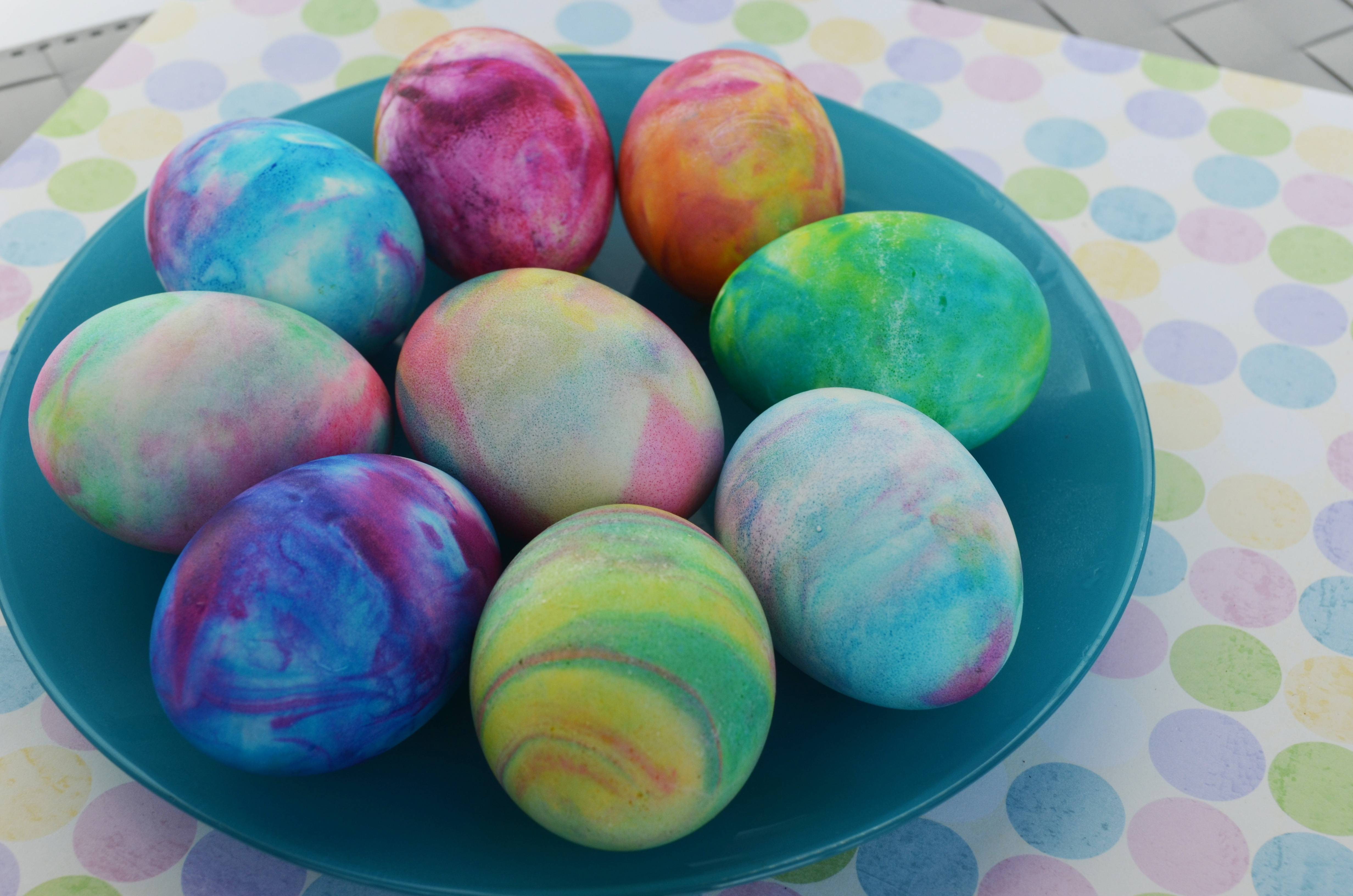 This year, try shaving cream and liquid food coloring to dye hard-boiled eggs, which gives them a tie-dyed effect.