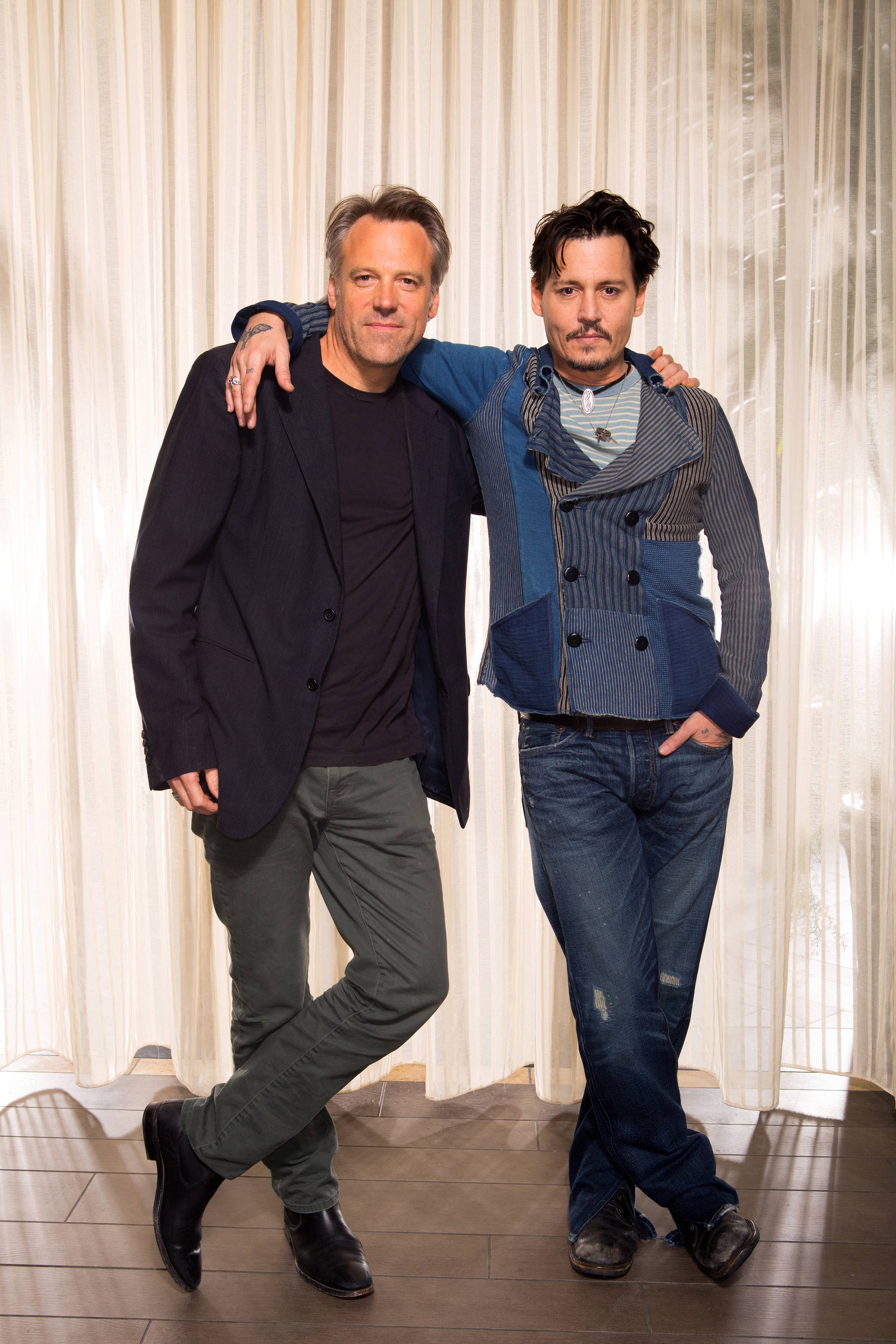 "Johnny Depp, right, poses with director (and Elmhurst native) Wally Pfister. The two worked together on ""Transcendence."""