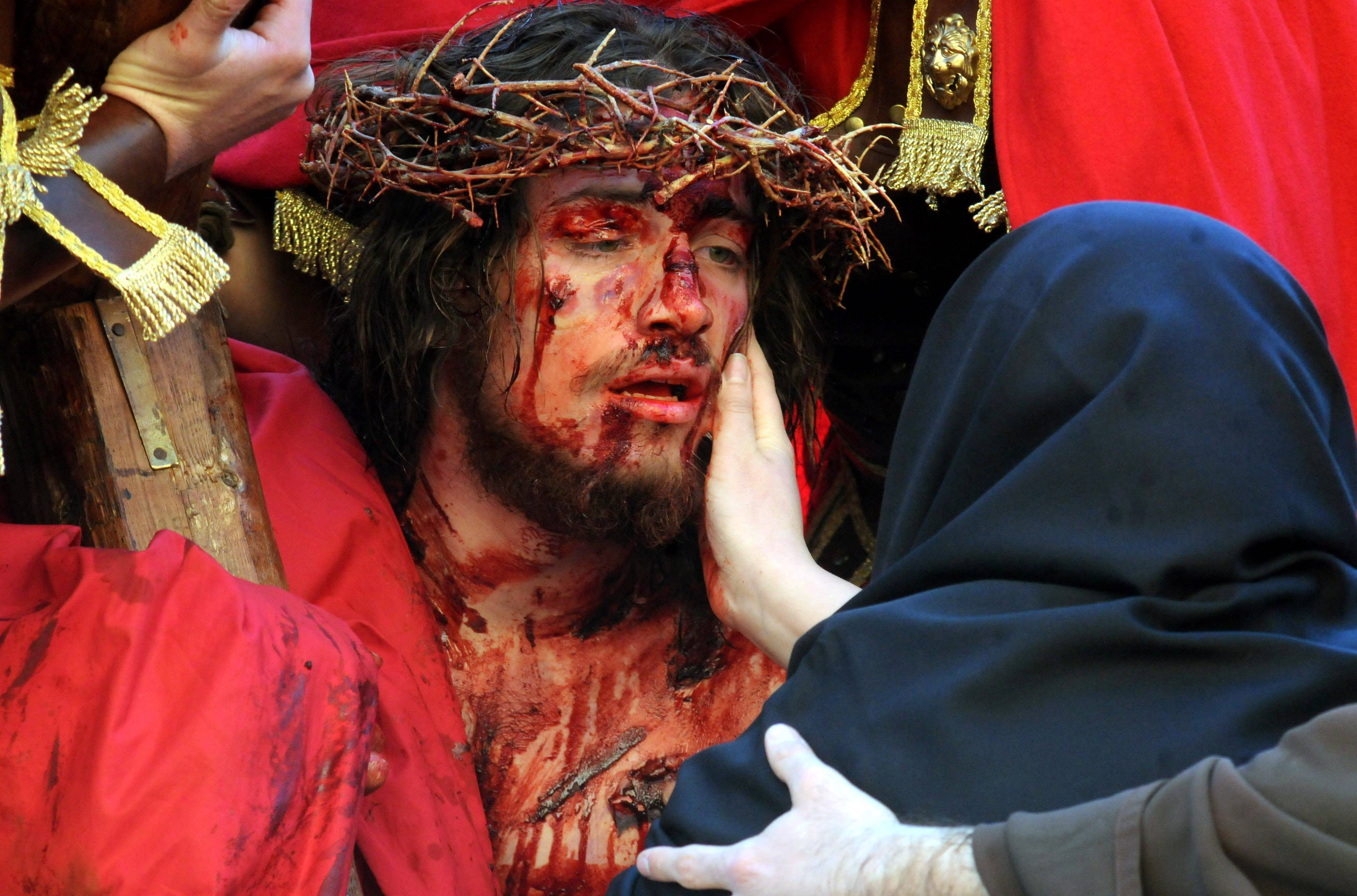 Portraying Jesus Christ a man takes part in a Way of the Cross procession, at the Saint Isidoro Agricola church in Palermo, Sicily.
