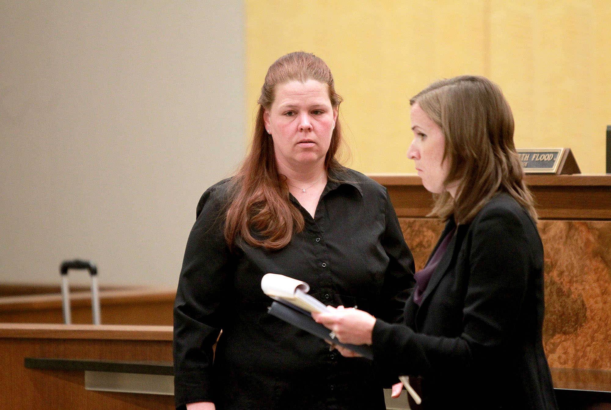 Stacy Fiebelkorn, left, confers with her attorney, Alexis Costello, during an appearance before Kane County Associate Judge Elizabeth Flood in an animal neglect case Thursday at the St. Charles branch court.
