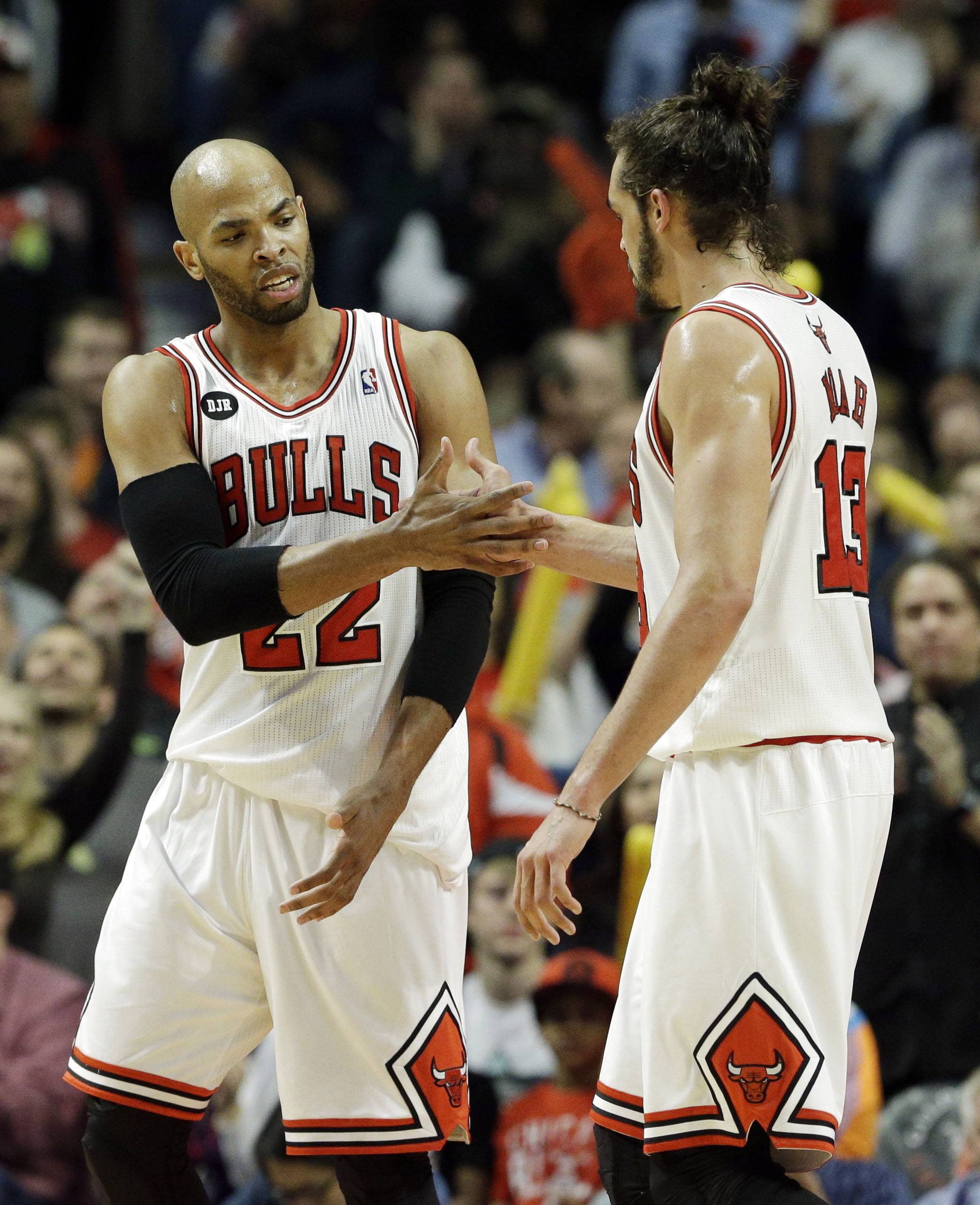 Chicago Bulls forward Taj Gibson, left, celebrates with center Joakim Noah after scoring a basket during the second half of an NBA basketball game against the Detroit Pistons in Chicago on Friday, April 11, 2014. The Bulls won 106-98. (AP Photo/Nam Y. Huh)