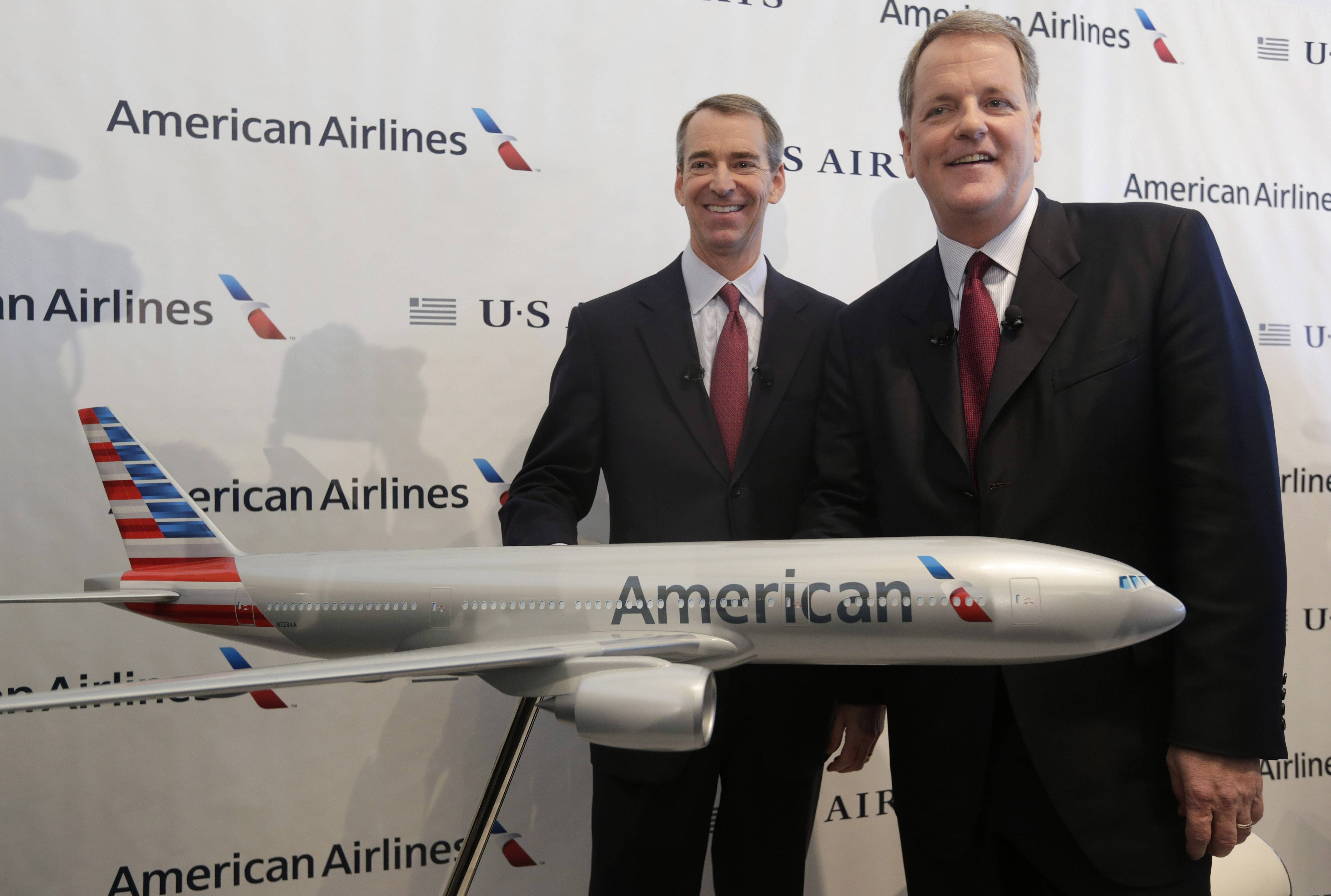 U.S. Airways CEO Doug Parker, right, and American Airlines CEO Tom Horton pose after a news conference at DFW International Airport.