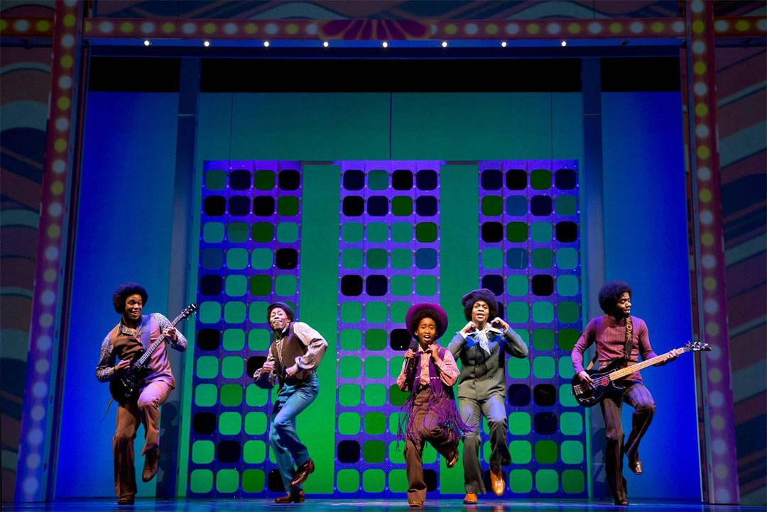 "Raymond Luke, Jr. stars as Michael Jackson, center, in the 2013 Broadway production of ""Motown The Musical."" The national tour of the show launches in Chicago at the Oriental Theatre for a 12-week run starting Tuesday, April 22."